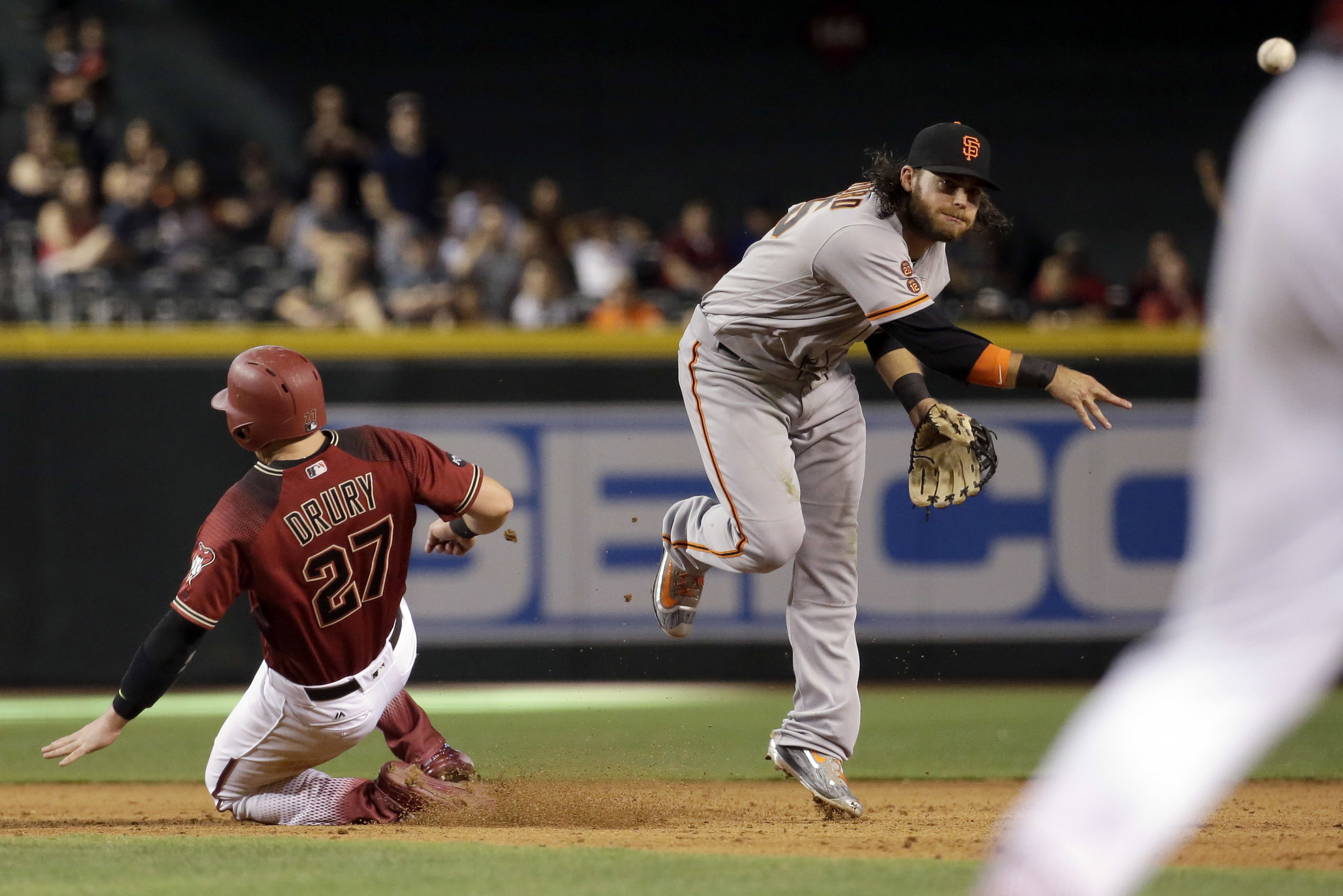 Arizona Diamondbacks' Brandon Drury (27) is forced out at second by San Francisco Giants' Brandon Crawford (35) who turns a baseball game-ending double play against Rickie Weeks Jr. during the ninth inning of a baseball game, Sunday, May 15, 2016, in Phoe