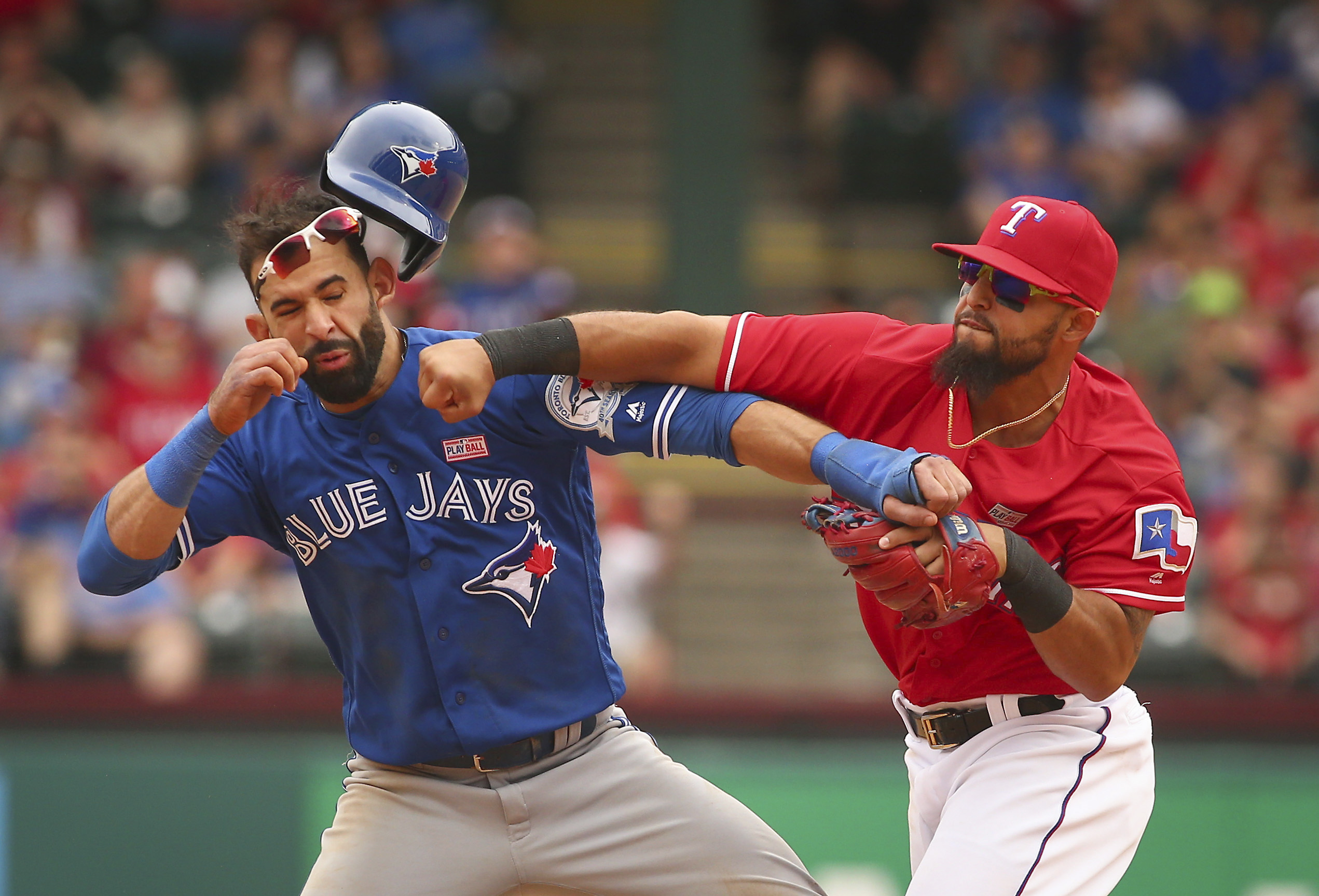 Toronto Blue Jays Jose Bautista (19) gets hit by Texas Rangers second baseman Rougned Odor (12) after Bautista slid into second in the eighth inning of a baseball game at Globe Life Park in Arlington, Texas, Sunday May 15, 2016. (Richard W. Rodriguez/Star