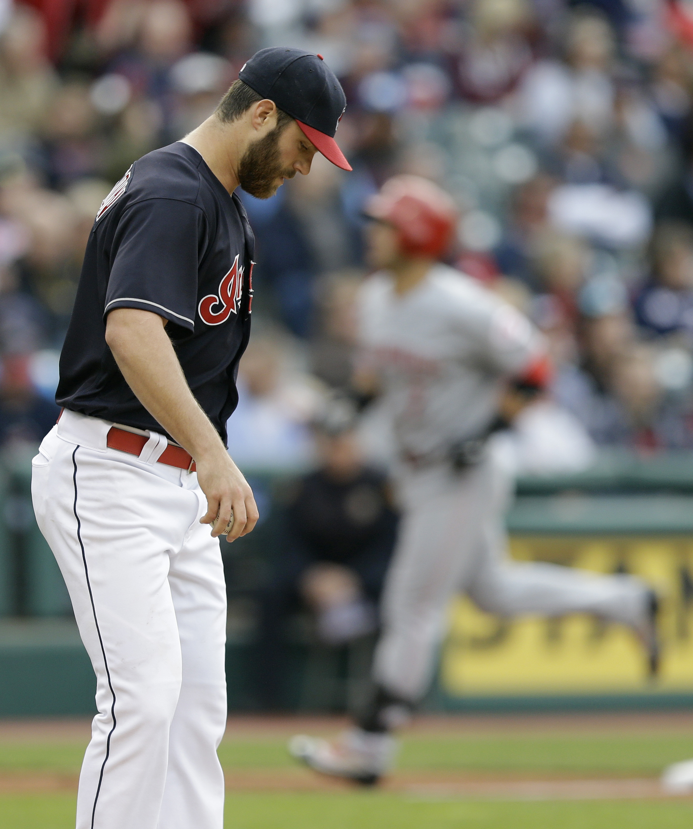 Cleveland Indians starting pitcher Cody Anderson, left, waits for Cincinnati Reds' Eugenio Suarez, right, to run the bases after Suarez hit a two-run home run off Anderson in the third inning of an interleague baseball game, Monday, May 16, 2016, in Cleve