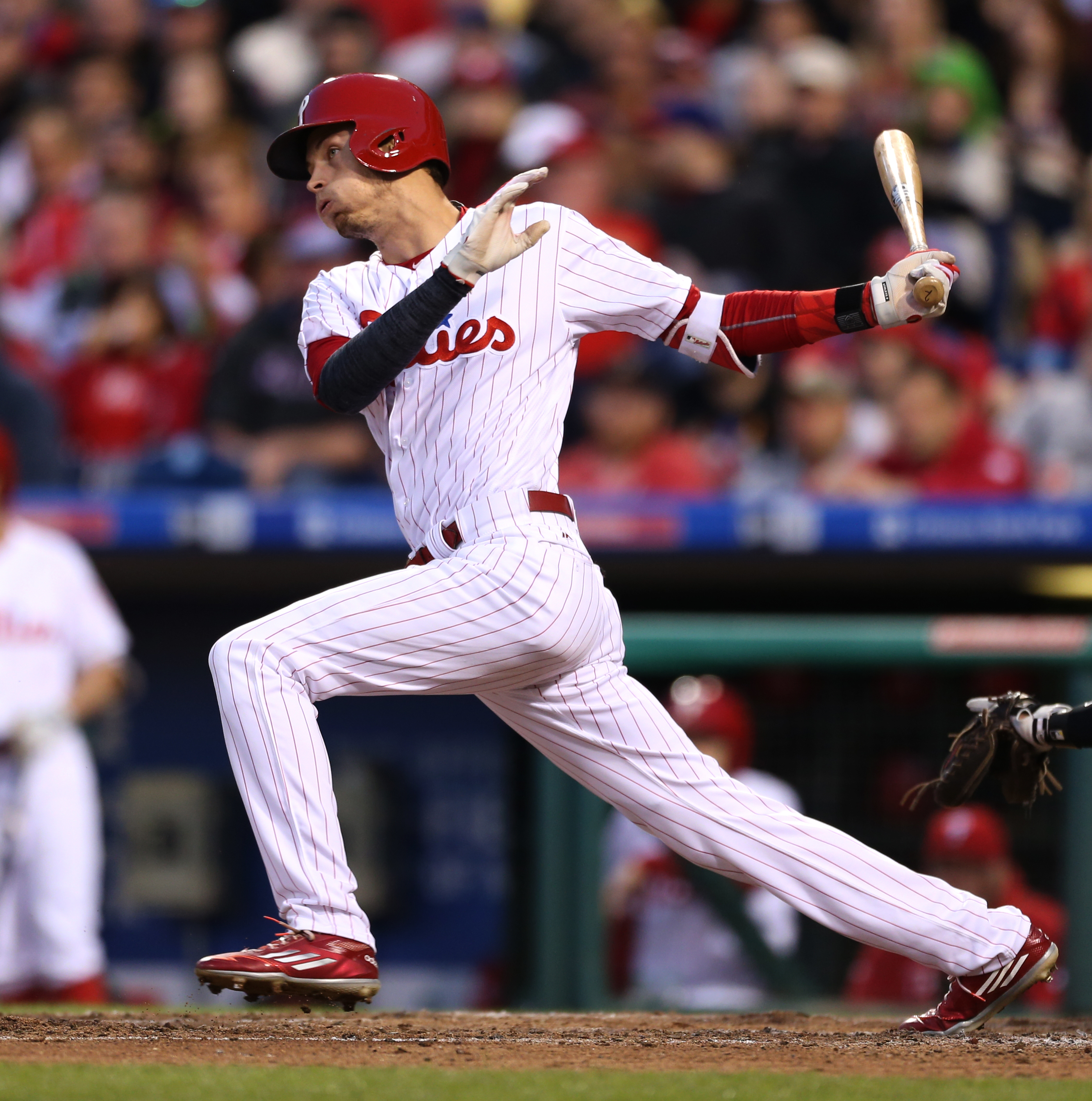 Philadelphia Phillies' Tyler Goeddel follows through on an RBI single allowing Carlos Ruiz to score on a pitch by Miami Marlins starting pitcher Adam Conley in the fourth inning of a baseball game, Monday, May 16, 2016, in Philadelphia. (AP Photo/Laurence