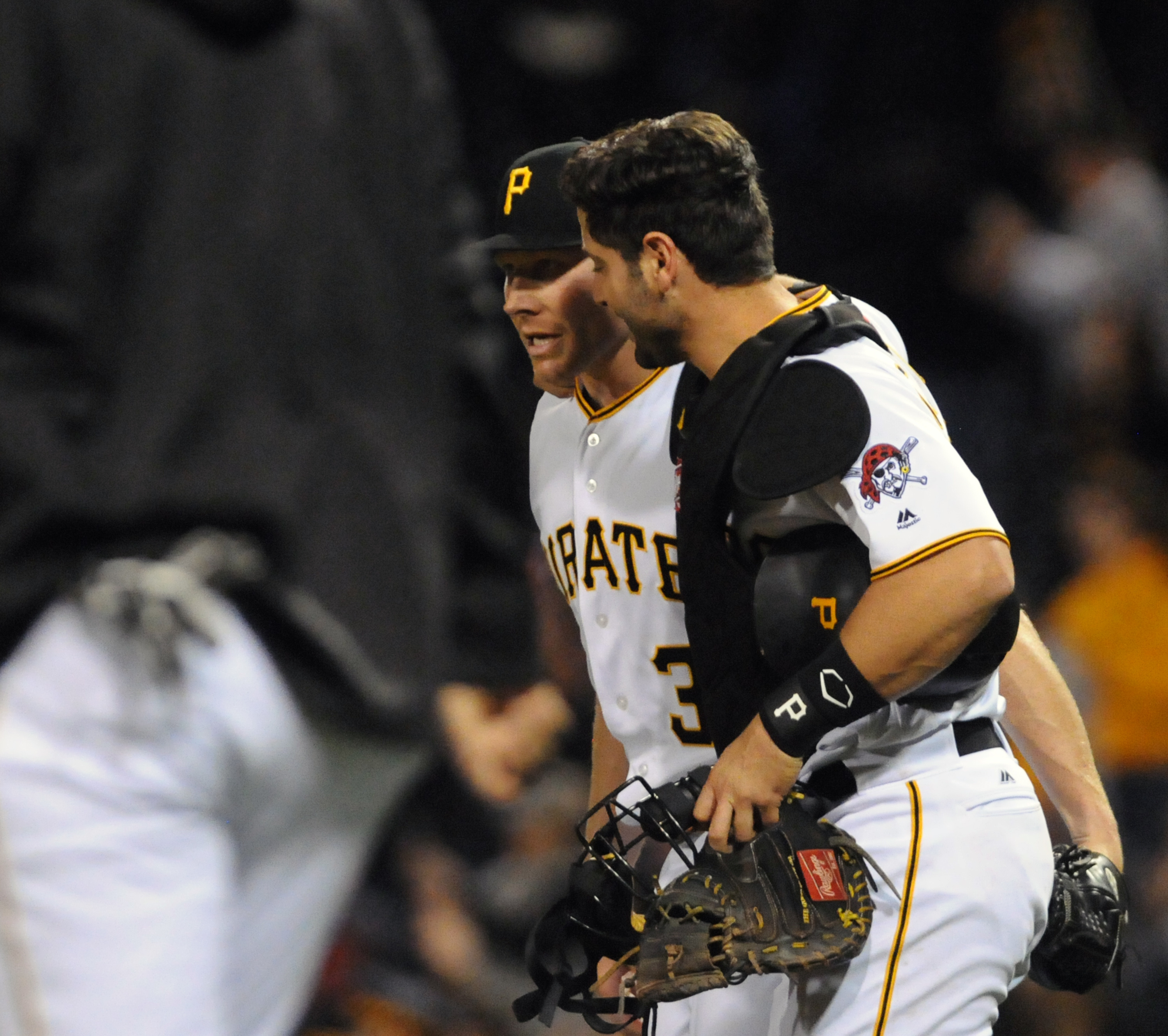 Pittsburgh Pirates' pitcher, Mark Melancon, left, with catcher, Francisco Cervelli, right, after Melancon got his 12th save of the season as the Pittsburgh Pirates win over the Atlanta Braves 8-5 in a baseball game, Monday, May 16, 2016 in Pittsburgh. (AP