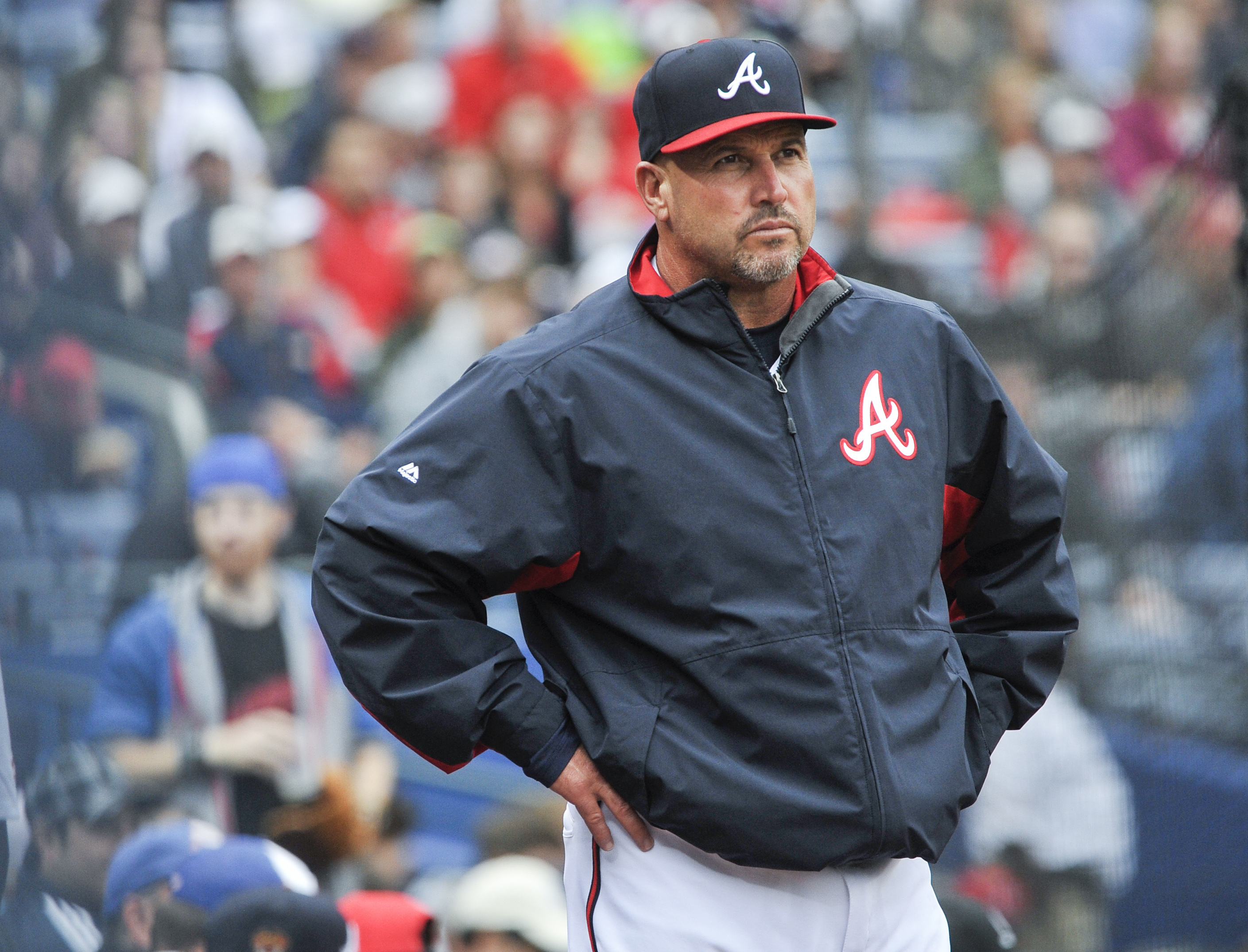 FILe - In this Oct. 4, 2015, file photo, Atlanta Braves manager Fredi Gonzalez (33) waits for a review of a call during the fourth inning of the second baseball game of a doubleheader against the St. Louis Cardinals, in Atlanta. The Atlanta Braves have fi