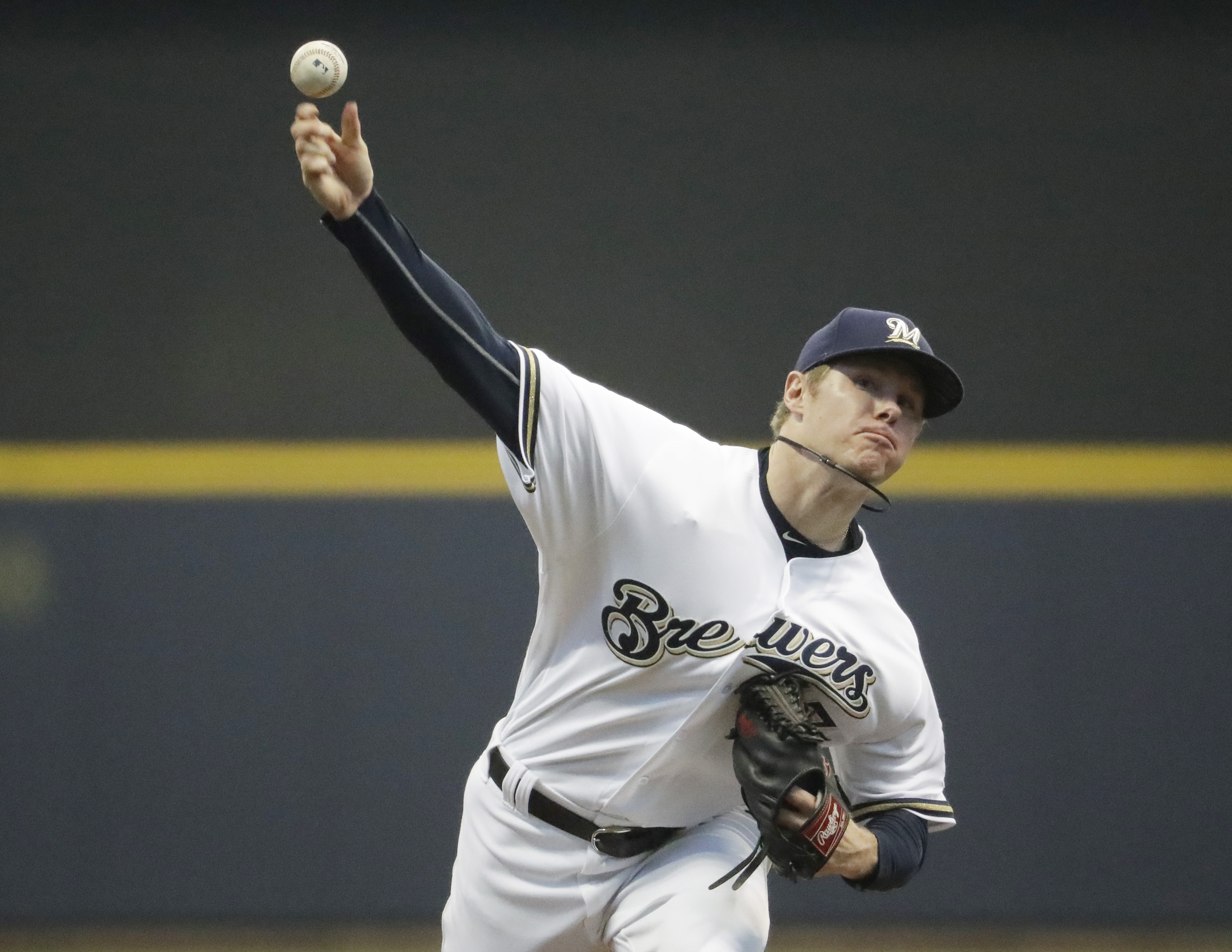 Milwaukee Brewers starting pitcher Chase Anderson throws during the first inning of a baseball game against the Chicago Cubs Tuesday, May 17, 2016, in Milwaukee. (AP Photo/Morry Gash)
