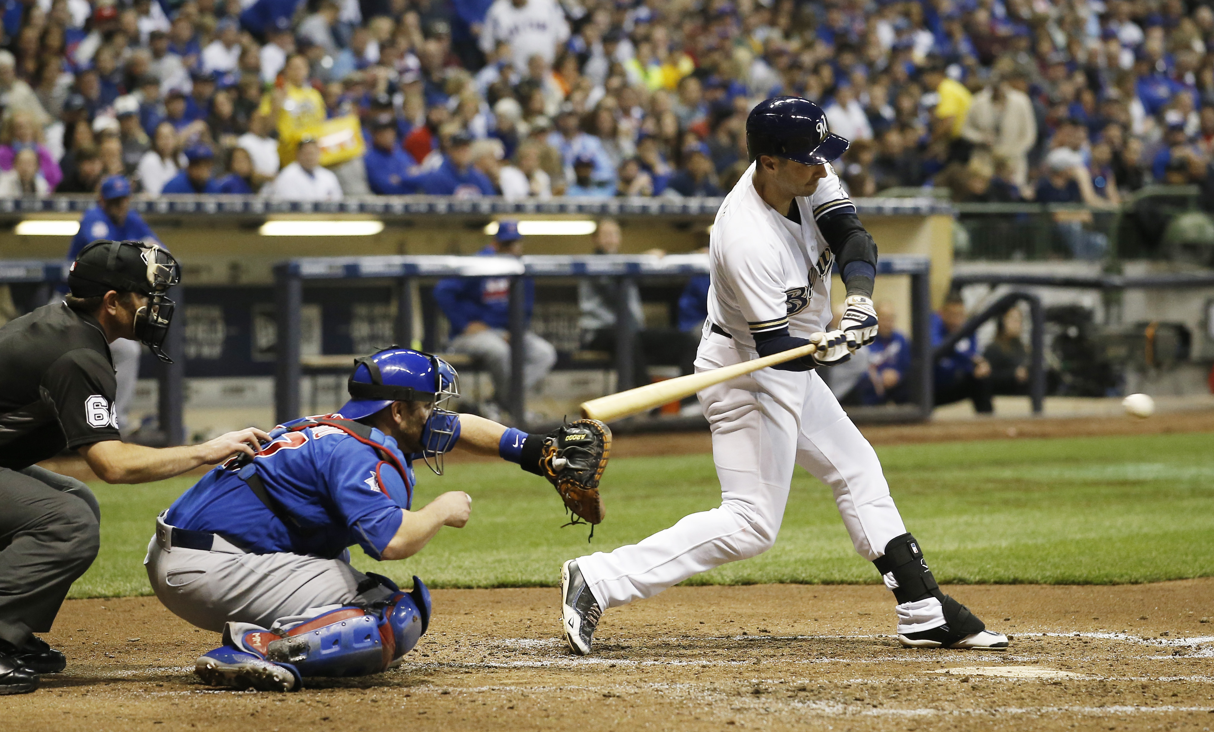Milwaukee Brewers' Ryan Braun hits an RBI single during the sixth inning of a baseball game against the Chicago Cubs Tuesday, May 17, 2016, in Milwaukee. (AP Photo/Morry Gash)