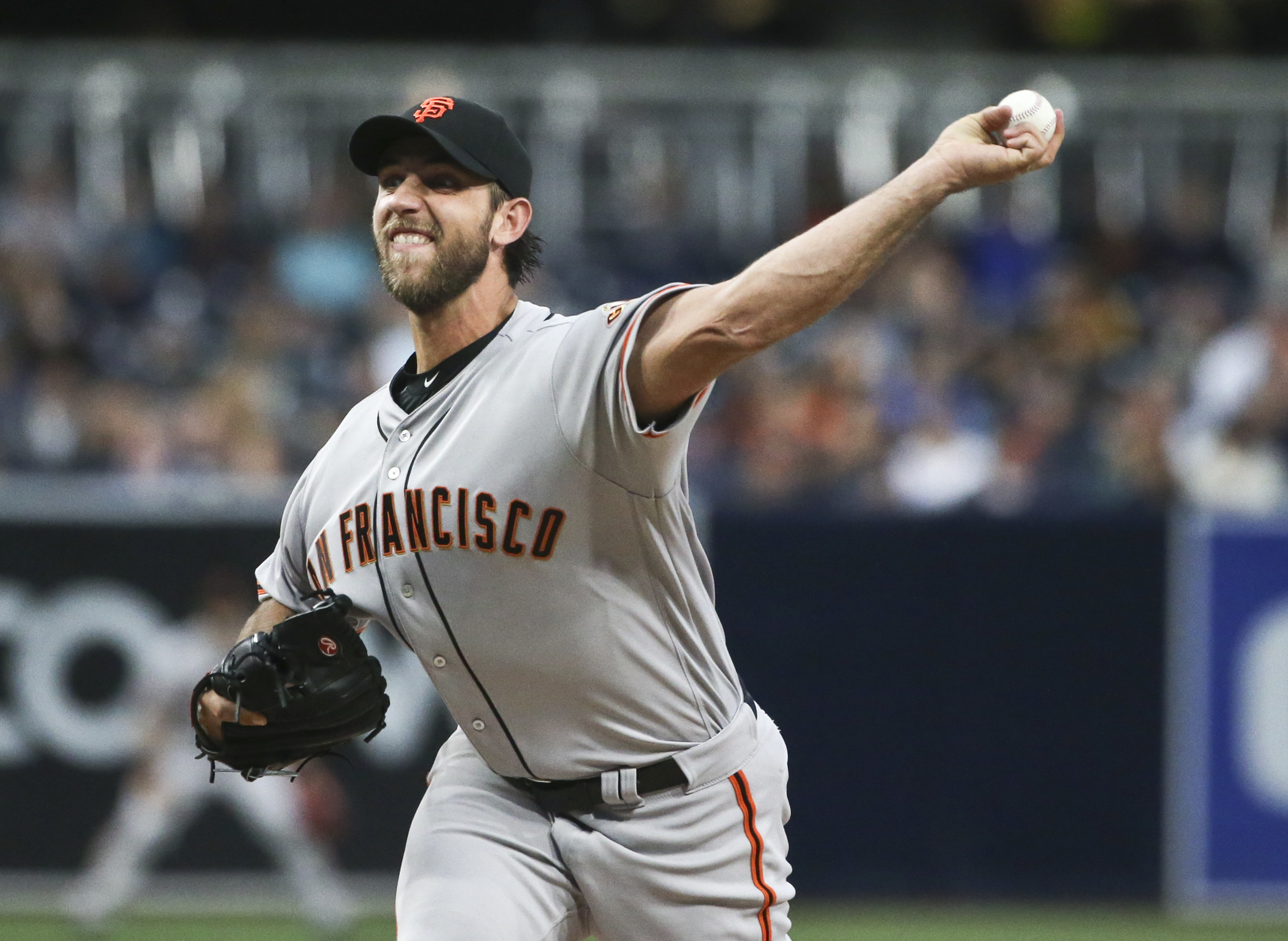 San Francisco Giants starting pitcher Madison Bumgarner throws against the San Diego Padres during the first inning of baseball game Tuesday, May 17, 2016, in San Diego. (AP Photo/Lenny Ignelzi)