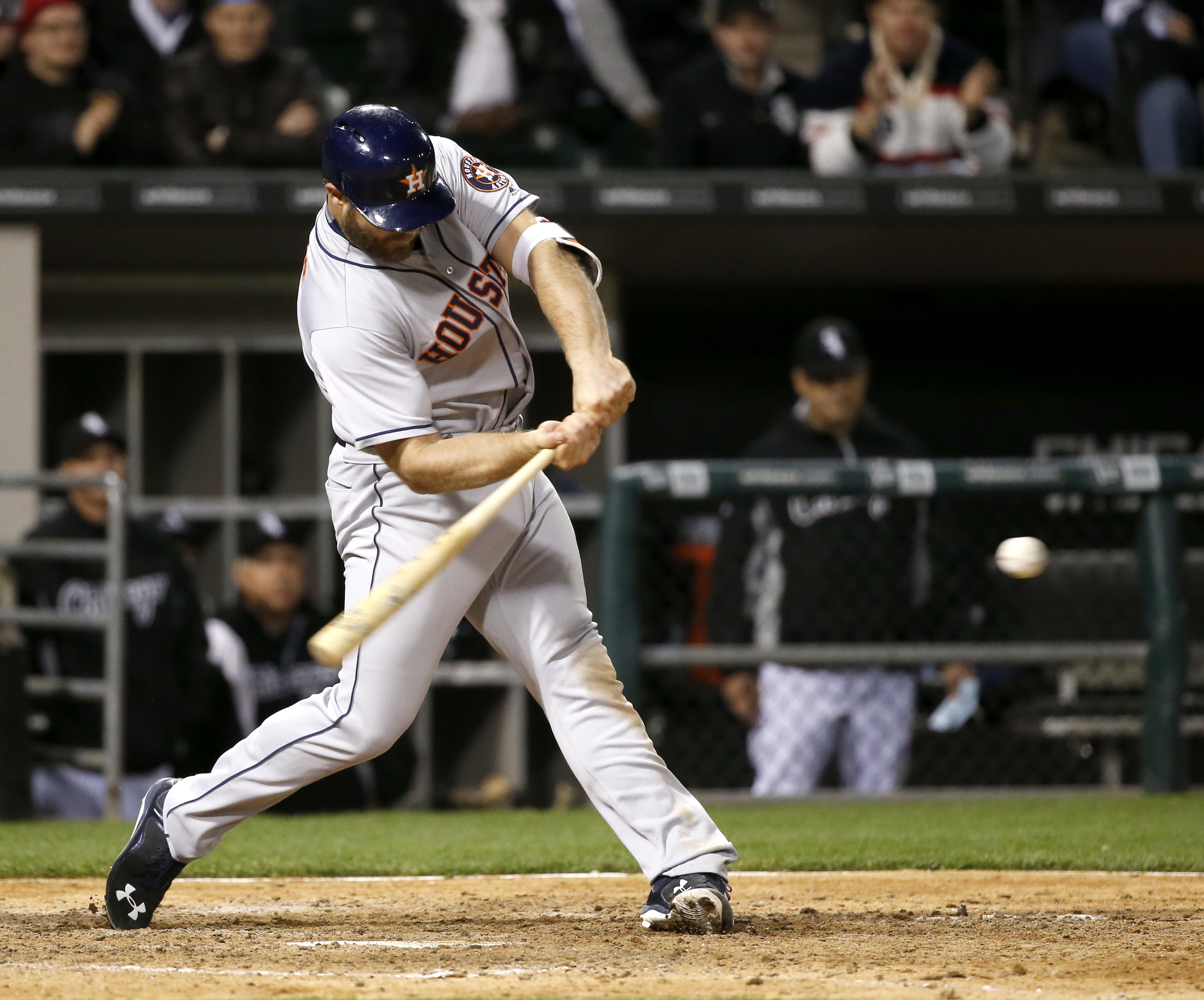 Houston Astros' Evan Gattis swings on a two-run home run off Chicago White Sox relief pitcher Matt Albers during the 11th inning of a baseball game Tuesday, May 17, 2016, in Chicago. (AP Photo/Charles Rex Arbogast)