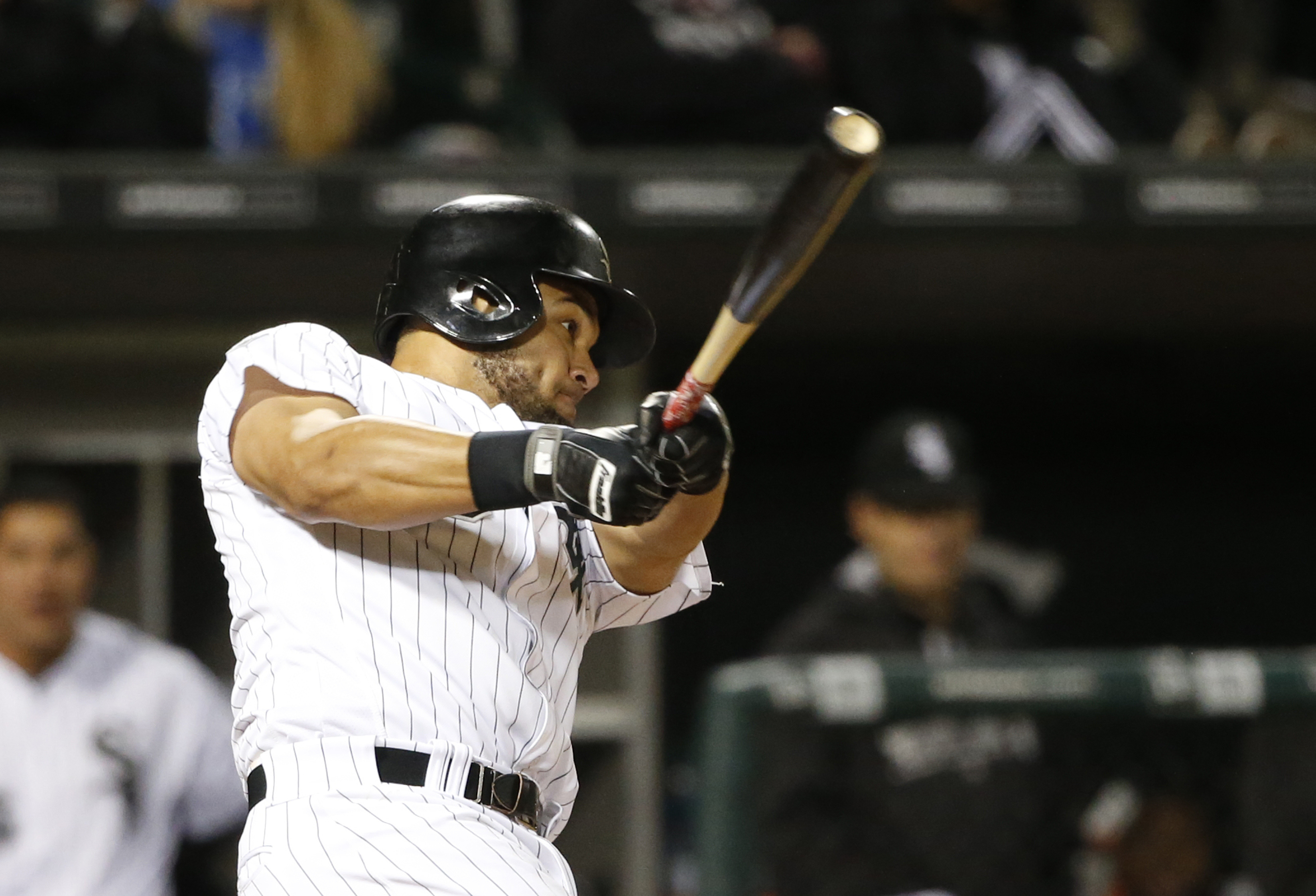 Chicago White Sox's Melky Cabrera hits an RBI triple off Houston Astros starting pitcher Doug Fister, scoring Todd Frazier, during the sixth inning of a baseball game, Wednesday, May 18, 2016, in Chicago. (AP Photo/Charles Rex Arbogast)
