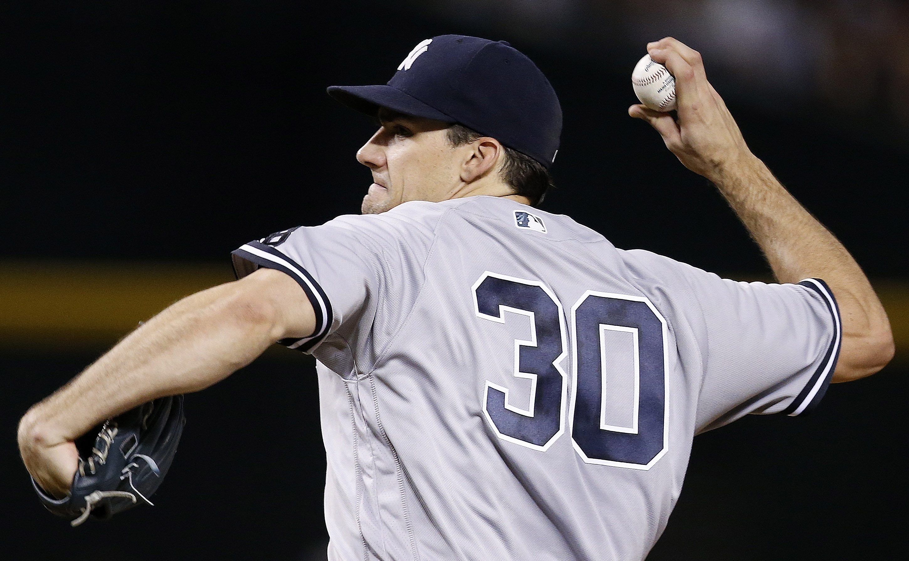 New York Yankees' Nathan Eovaldi throws a pitch against the Arizona Diamondbacks during the fourth inning of a baseball game Wednesday, May 18, 2016, in Phoenix. (AP Photo/Ross D. Franklin)