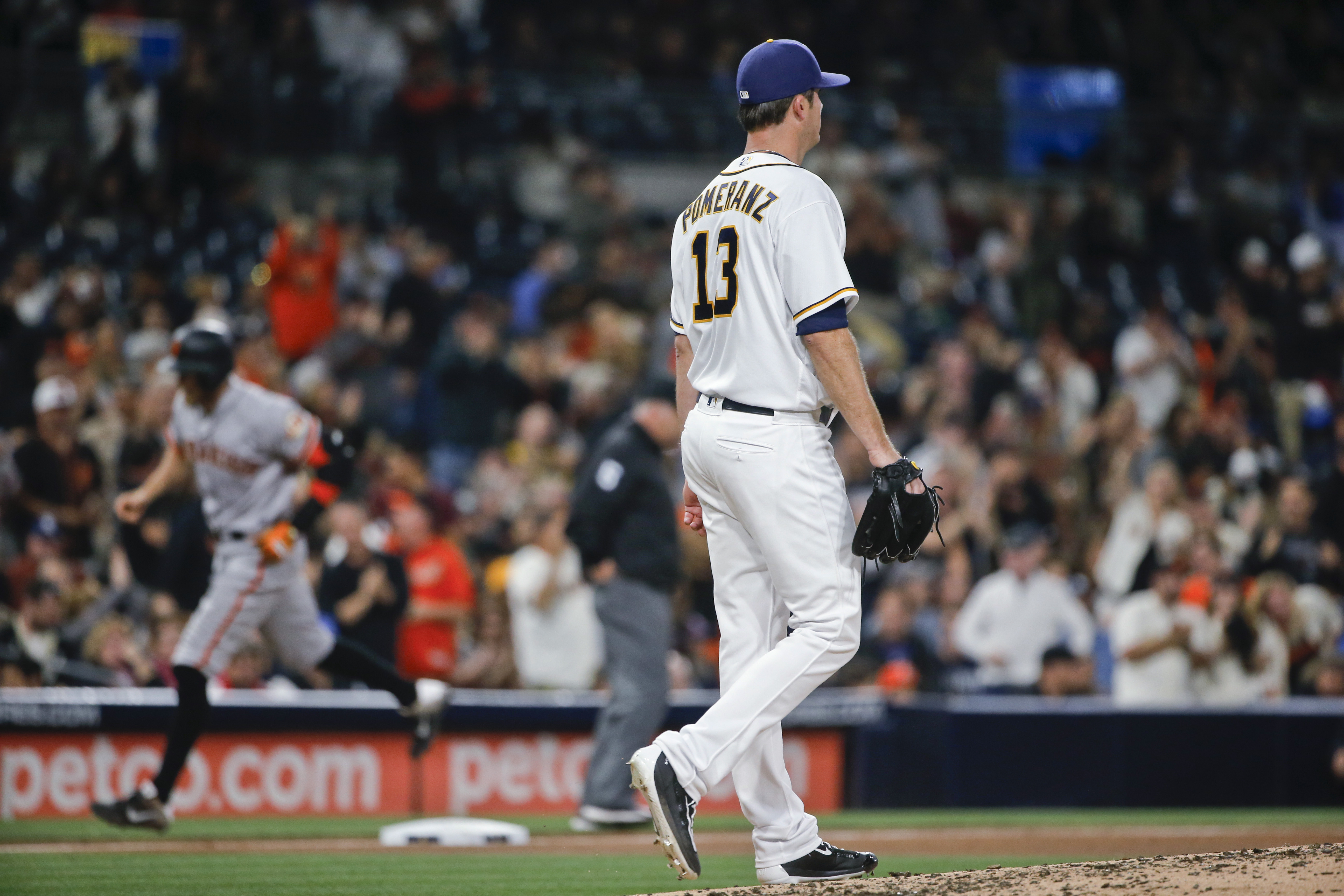 San Diego Padres starting pitcher Drew Pomeranz returns to the mound as San Francisco Giants' Hunter Pence rounds the bases with a two-run home run during the fourth inning of a baseball game Wednesday, May 18, 2016, in San Diego. (AP Photo/Lenny Ignelzi)