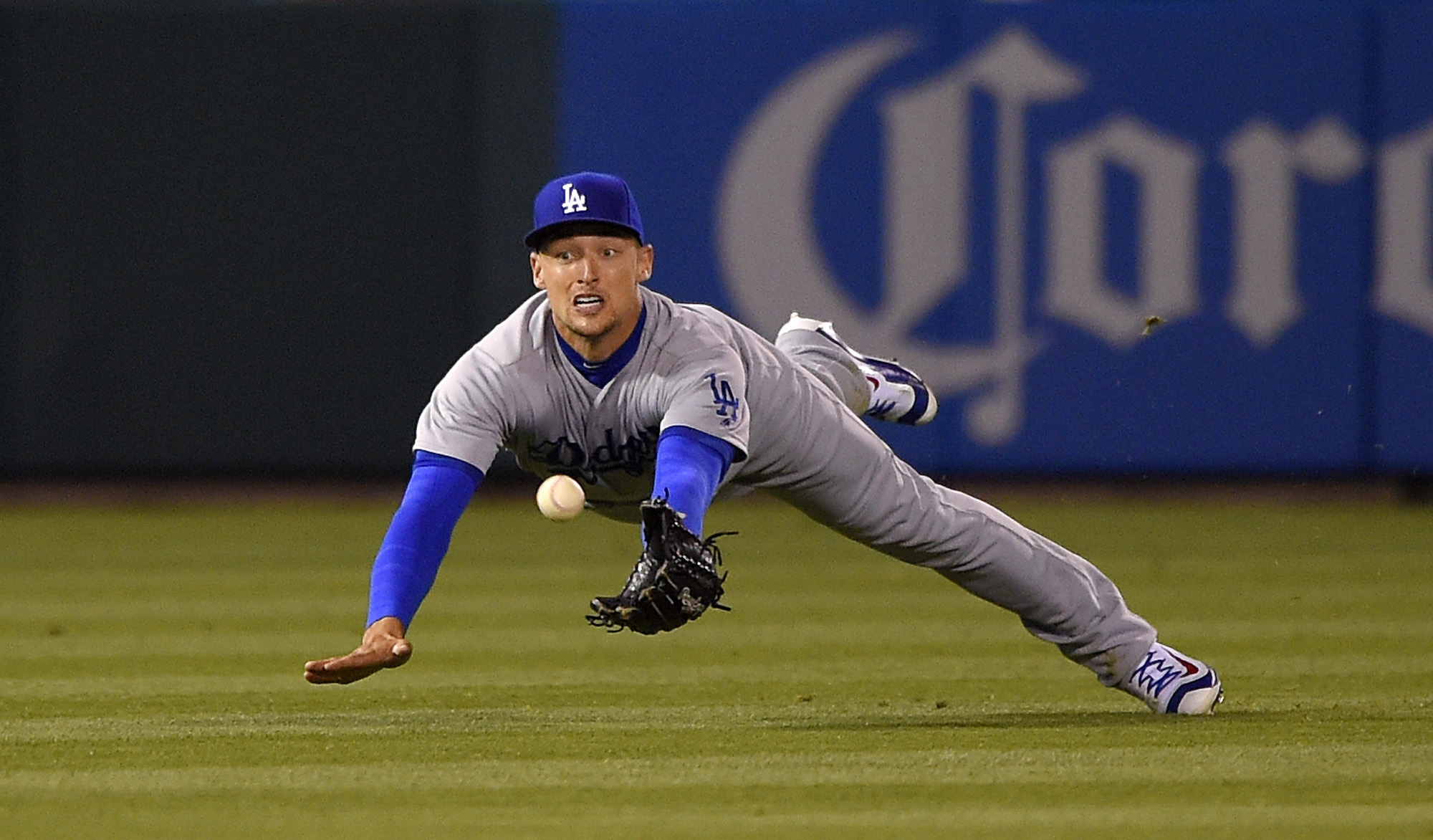 Los Angeles Dodgers left fielder Trayce Thompson can't get to a ball hit for a two-run double by Los Angeles Angels' Rafael Ortega during the fifth inning of a baseball game Wednesday, May 18, 2016, in Anaheim, Calif. (AP Photo/Mark J. Terrill)