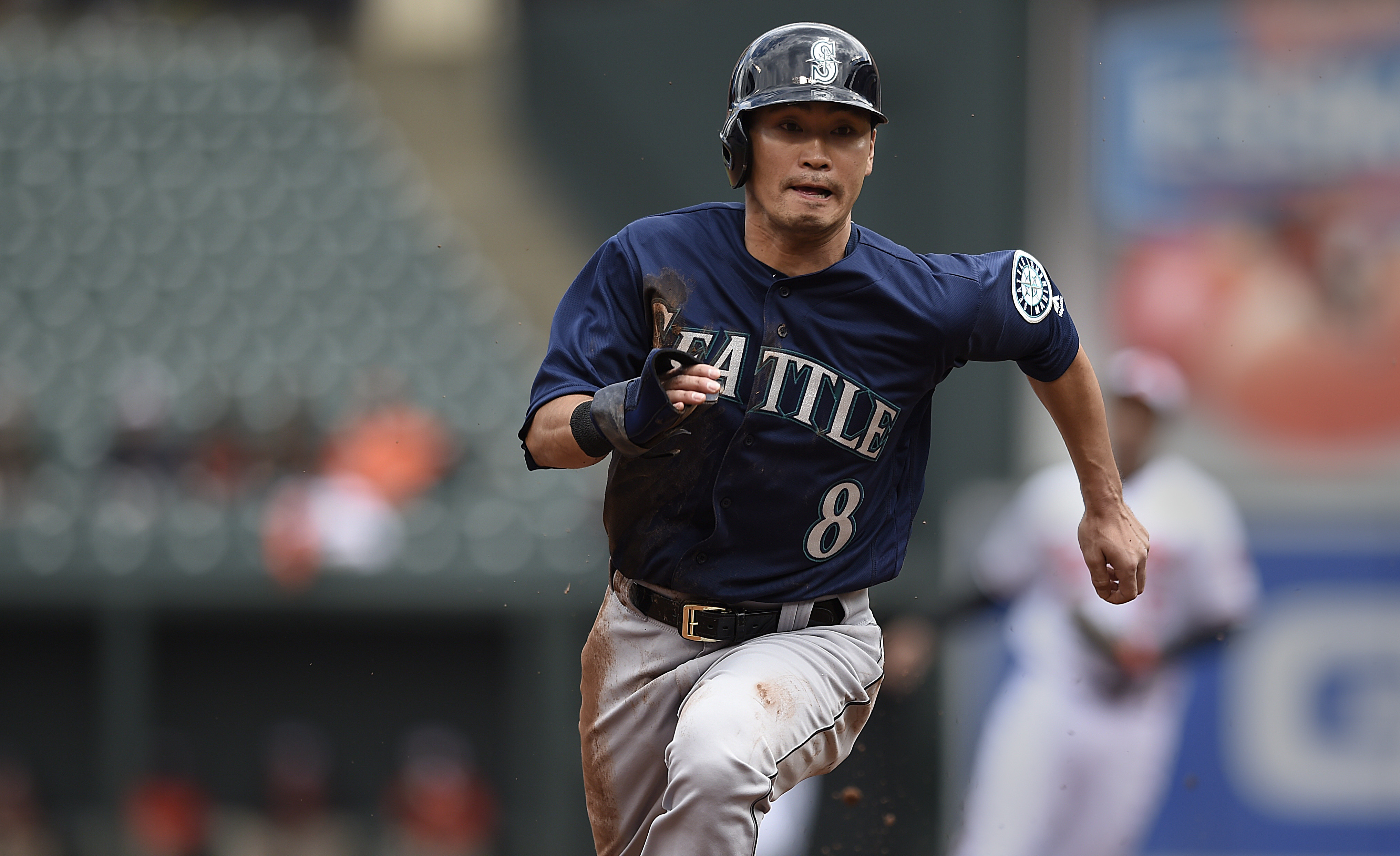 Seattle Mariners' Norichika Aoki races home to score on a single by Nelson Cruz in the first inning of a baseball game against the Baltimore Orioles, Thursday, May 19, 2016, in Baltimore. (AP Photo/Gail Burton)
