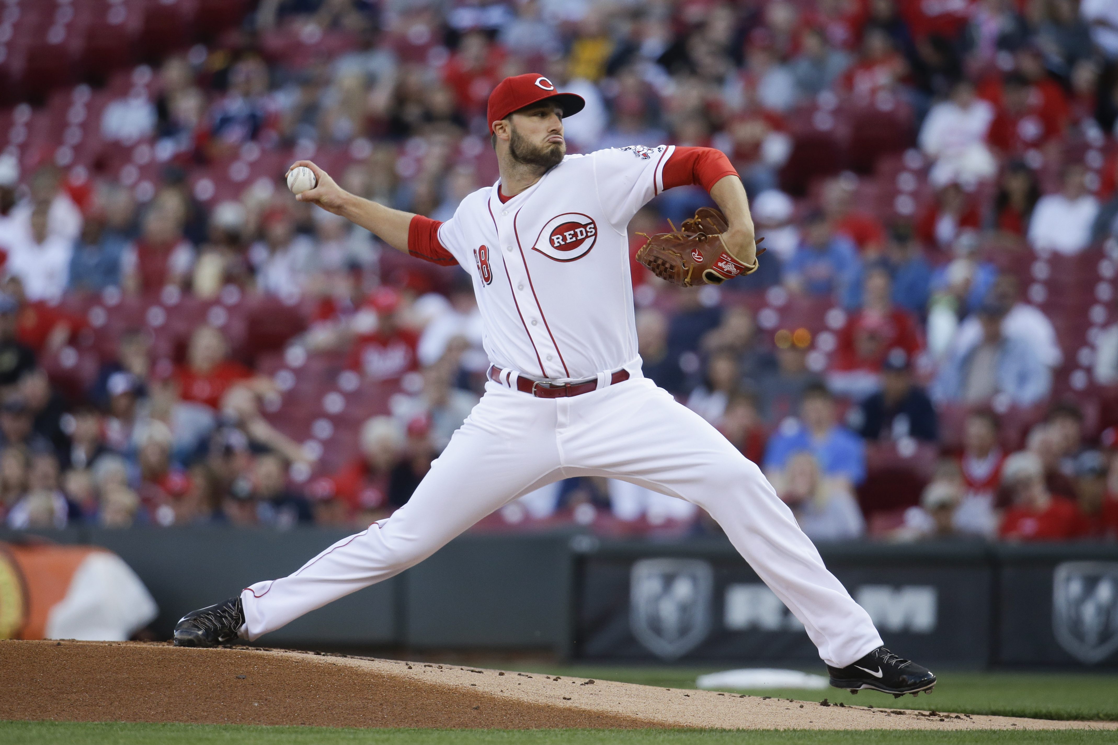 Cincinnati Reds starting pitcher Tim Adleman throws during the first inning of a baseball game against the Cleveland Indians, Thursday, May 19, 2016, in Cincinnati. (AP Photo/John Minchillo)