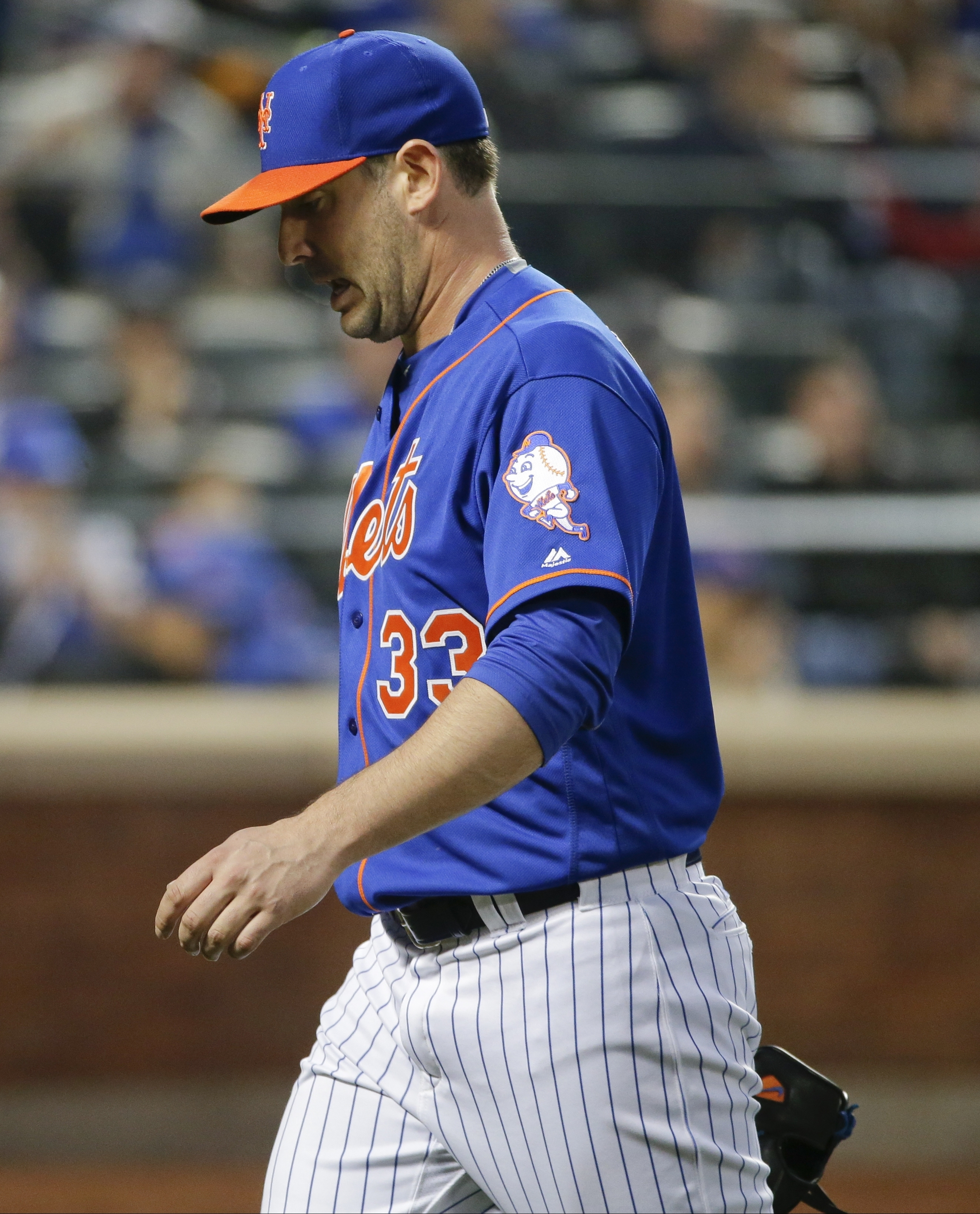 New York Mets' Matt Harvey (33) leaves the field during the third inning of a baseball game against the Washington Nationals, Thursday, May 19, 2016, in New York. (AP Photo/Frank Franklin II)