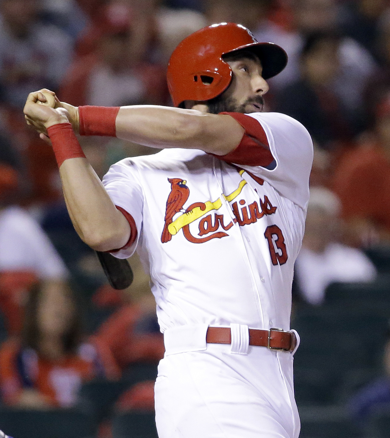 St. Louis Cardinals' Matt Carpenter watches his three-run home run during the eighth inning of a baseball game against the Colorado Rockies on Thursday, May 19, 2016, in St. Louis. (AP Photo/Jeff Roberson)
