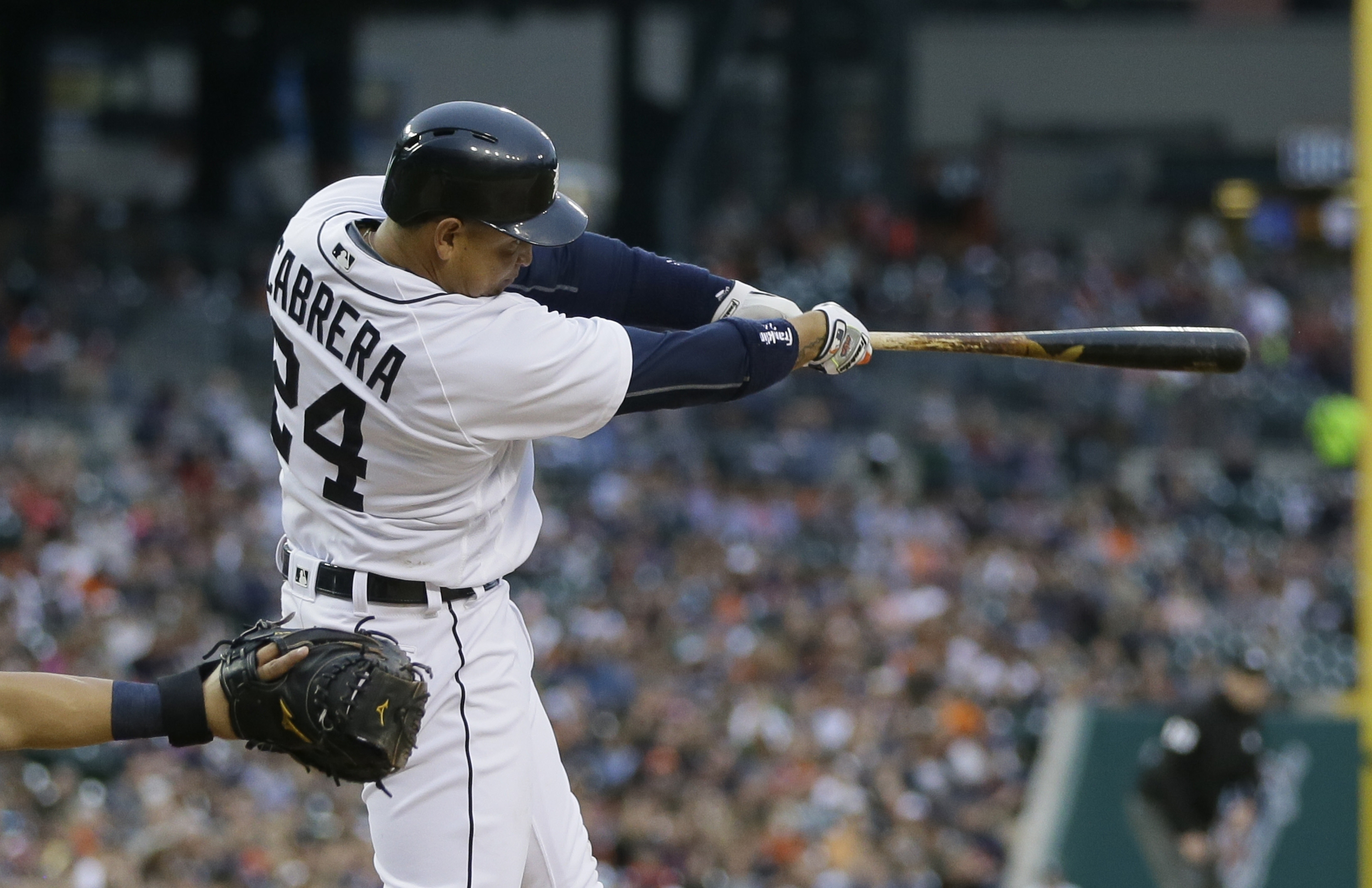 Detroit Tigers' Miguel Cabrera connects for a two-run home run during the third inning of a baseball game against the Tampa Bay Rays, Friday, May 20, 2016, in Detroit. (AP Photo/Carlos Osorio)