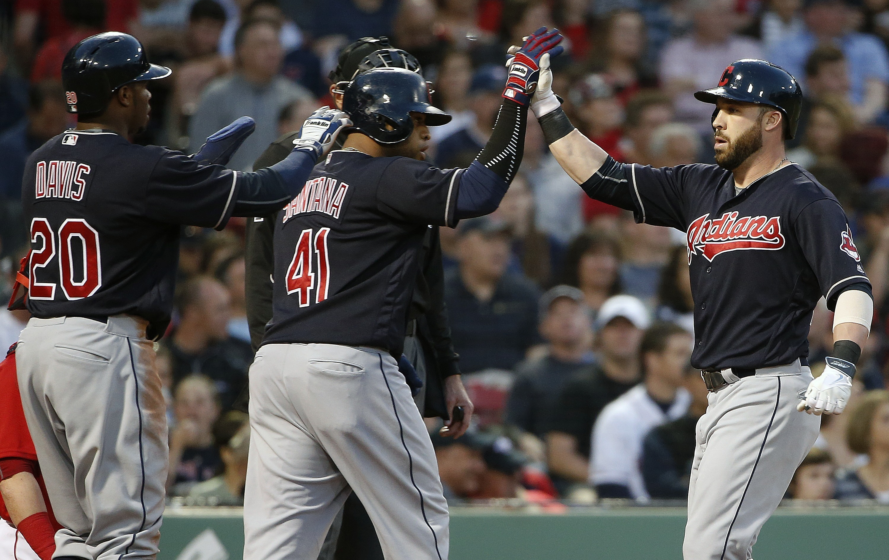 Cleveland Indians' Jason Kipnis, right, celebrates his three-run home run that also drove in Rajai Davis (20) and Carlos Santana (41) during the third inning of a baseball game against the Boston Red Sox in Boston, Friday, May 20, 2016. (AP Photo/Michael