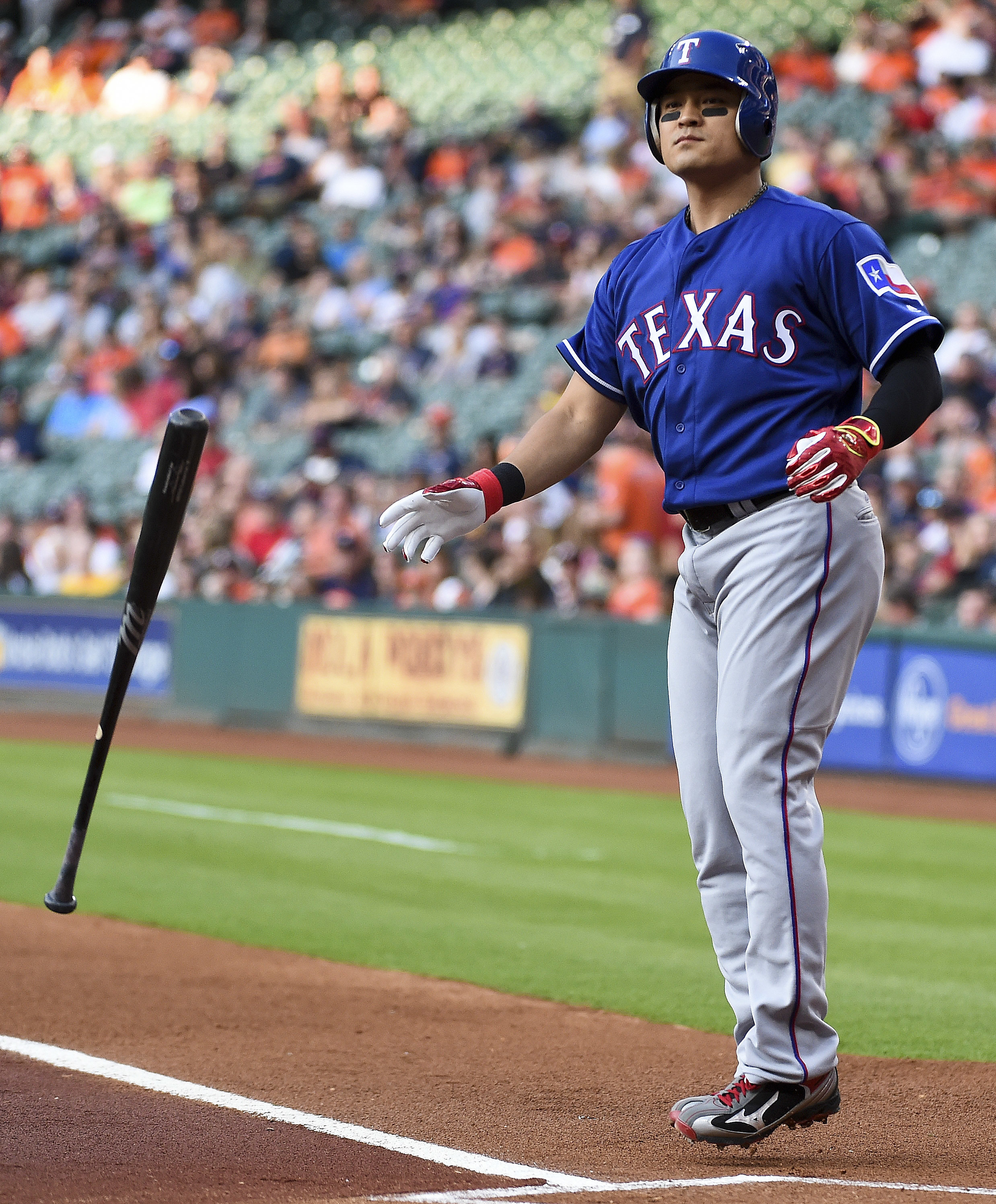 Texas Rangers' Shin-Soo Choo tosses his bat after walking in the first inning of a baseball game against the Houston Astros, Friday, May 20, 2016, in Houston. (AP Photo/Eric Christian Smith)