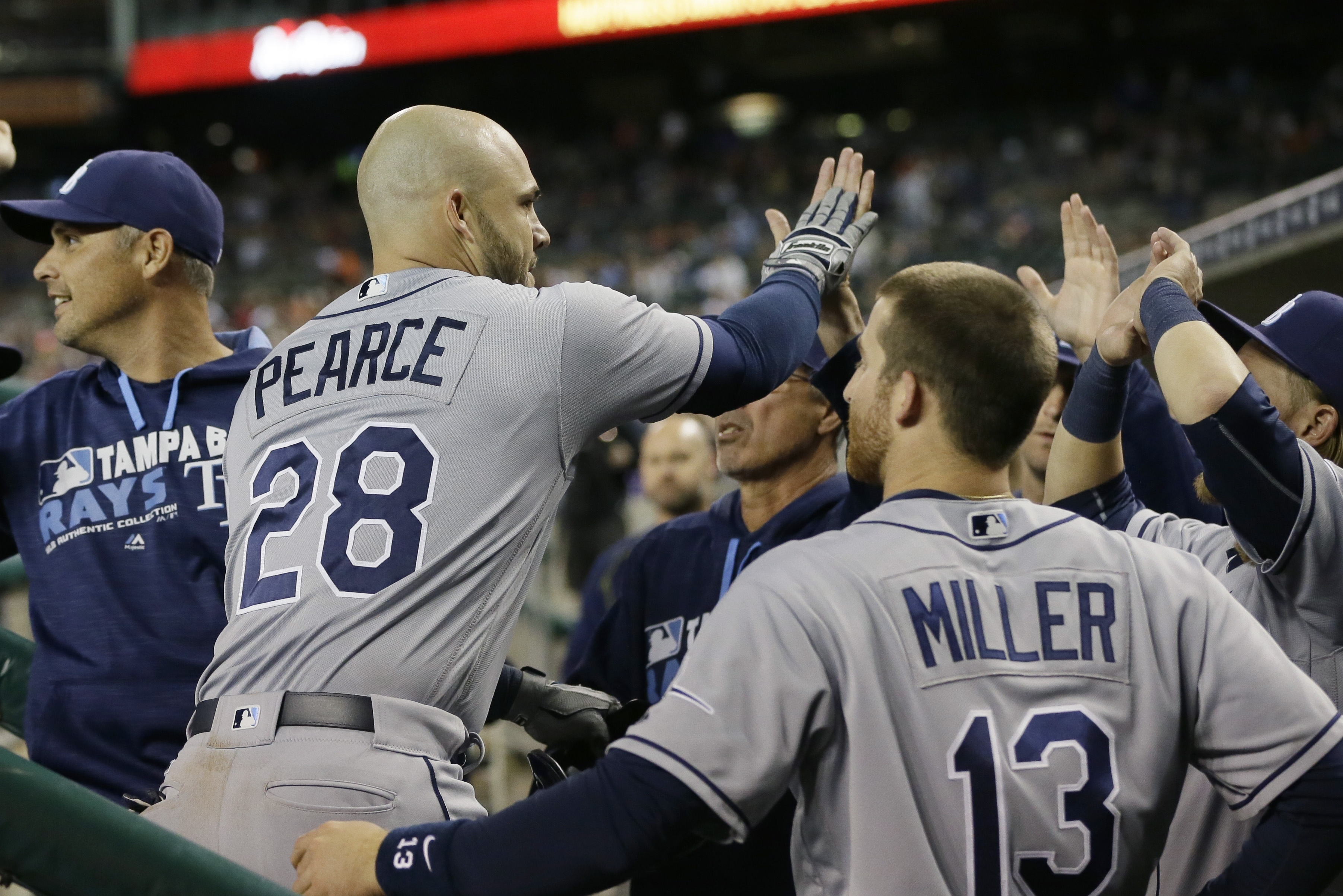Tampa Bay Rays' Steve Pearce is greeted by teammates after hitting a solo home run during the eighth inning of a baseball game against the Detroit Tigers Friday, May 20, 2016, in Detroit. (AP Photo/Carlos Osorio)