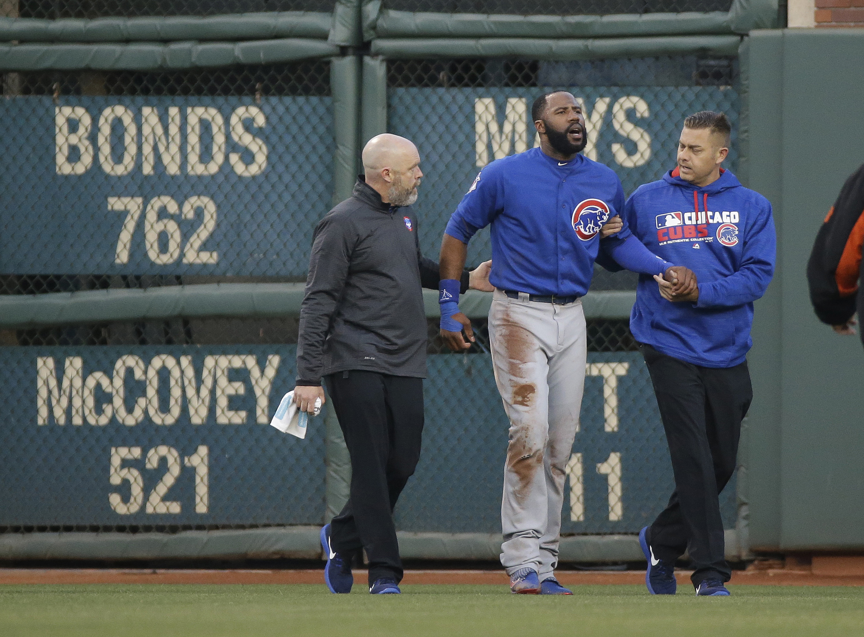 Chicago Cubs right fielder Jason Heyward is helped off the field after catching a fly ball hit by San Francisco Giants' Denard Span and crashing into the outfield wall during the first inning of their baseball game Friday, May 20, 2016, in San Francisco.