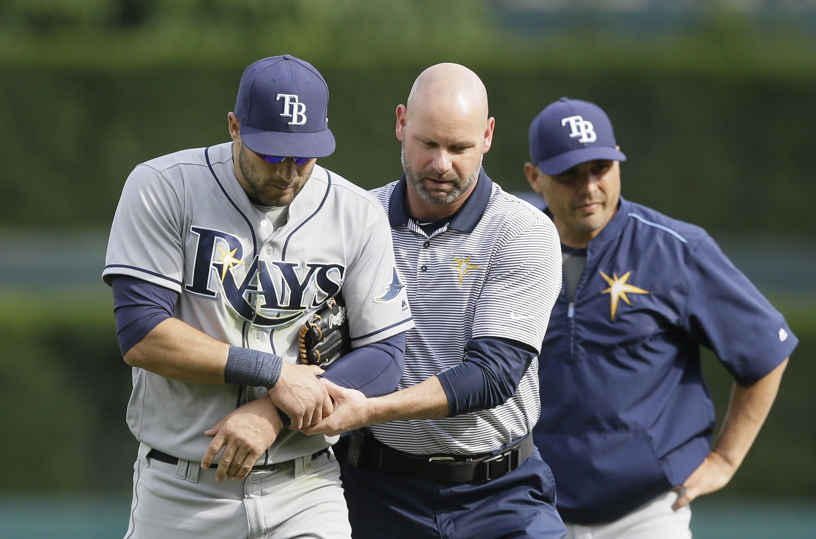 Tampa Bay Rays center fielder Kevin Kiermaier is helped off the field after getting injured diving for a single by Detroit Tigers' James McCann during the fifth inning of a baseball game, Saturday, May 21, 2016, in Detroit. (AP Photo/Carlos Osorio)