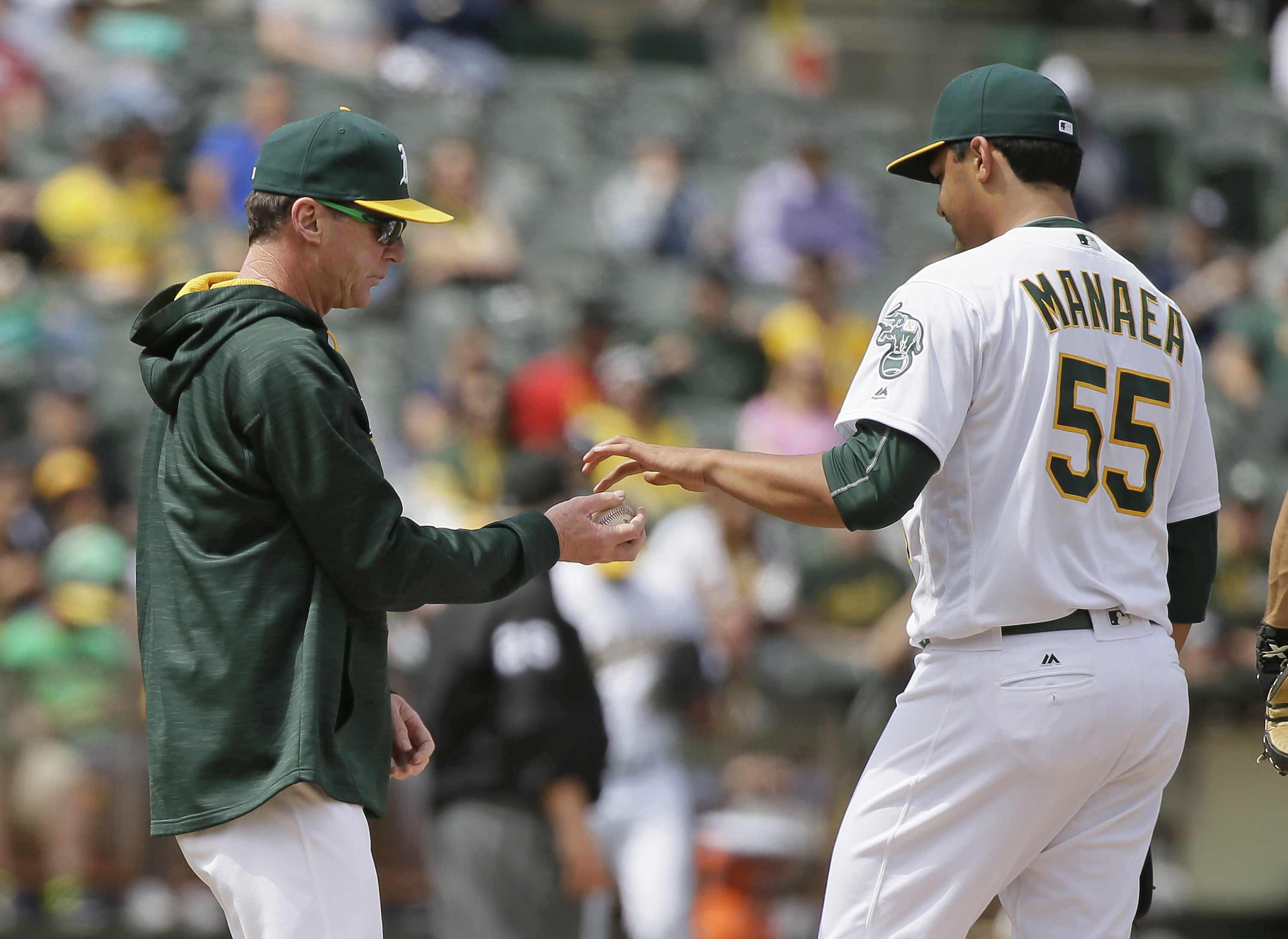 Oakland Athletics manager Bob Melvin, left, takes the ball from starting pitcher Sean Manaea, right, while removing him in the seventh inning of a baseball game against the New York Yankees, Saturday, May 21, 2016, in Oakland, Calif. (AP Photo/Eric Risber