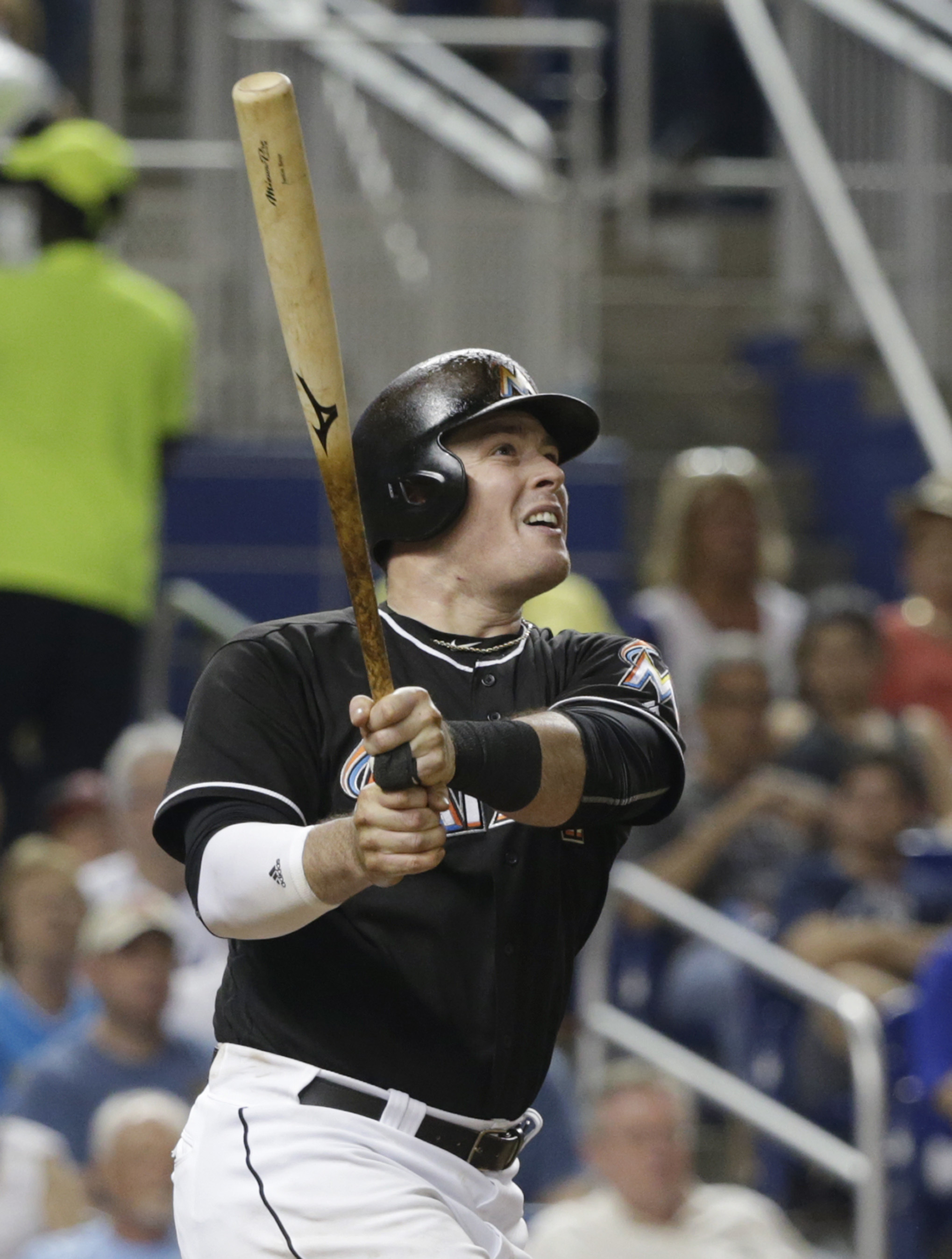 Miami Marlins' Justin Bour watches  after hitting a two-run home run hitting in Marcell Ozuna during the sixth inning of a baseball game against the Washington Nationals, Saturday, May 21, 2016, in Miami. (AP Photo/Wilfredo Lee)