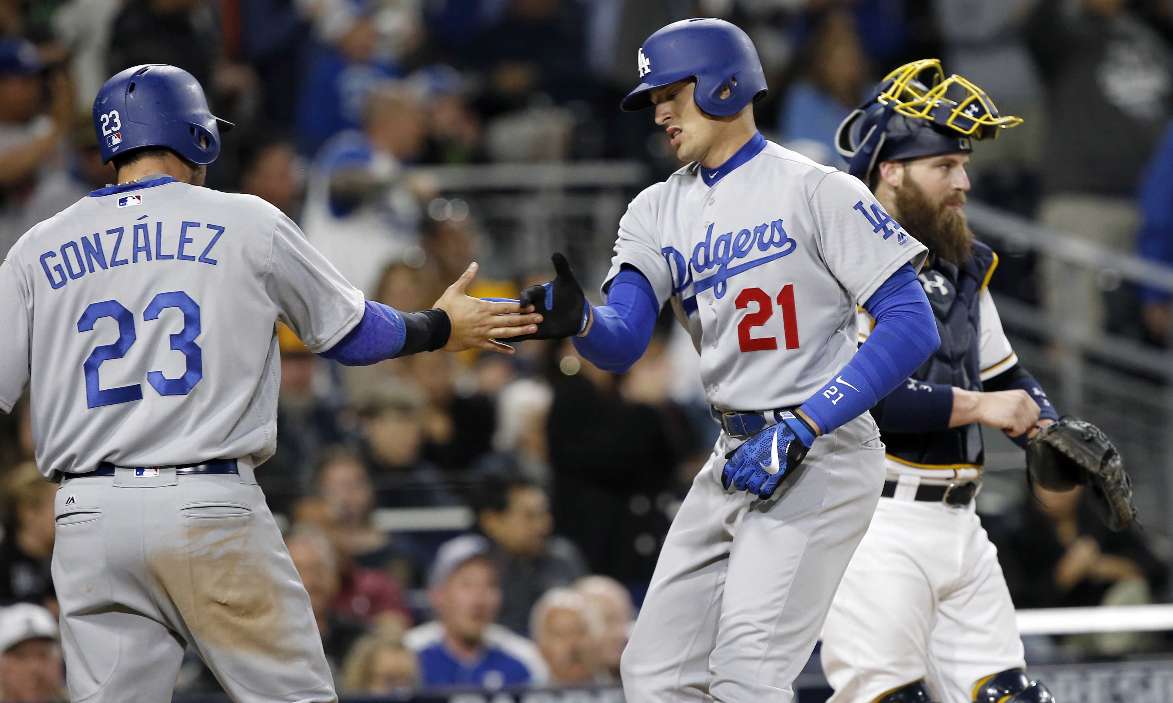Los Angeles Dodgers' Adrian Gonzalez, left, congratulates Trayce Thompson, who hit a two-run home run, as San Diego Padres catcher Derek Norris looks away during the seventh inning of a baseball game in San Diego, Saturday, May 21, 2016. (AP Photo/Alex Ga