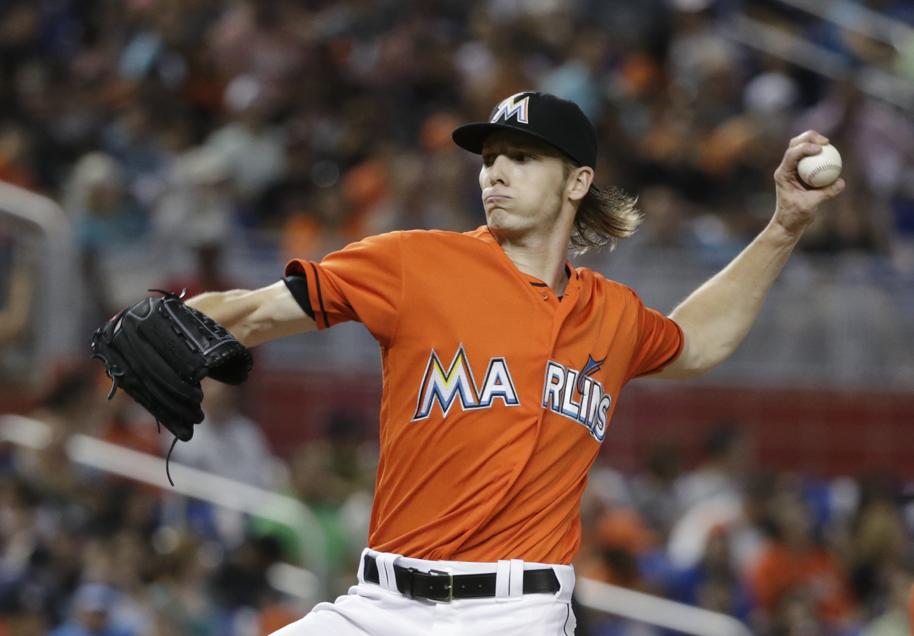 Miami Marlins' Adam Conley delivers a pitch during the first inning of a baseball game against the Washington Nationals, Sunday, May 22, 2016, in Miami. (AP Photo/Wilfredo Lee)