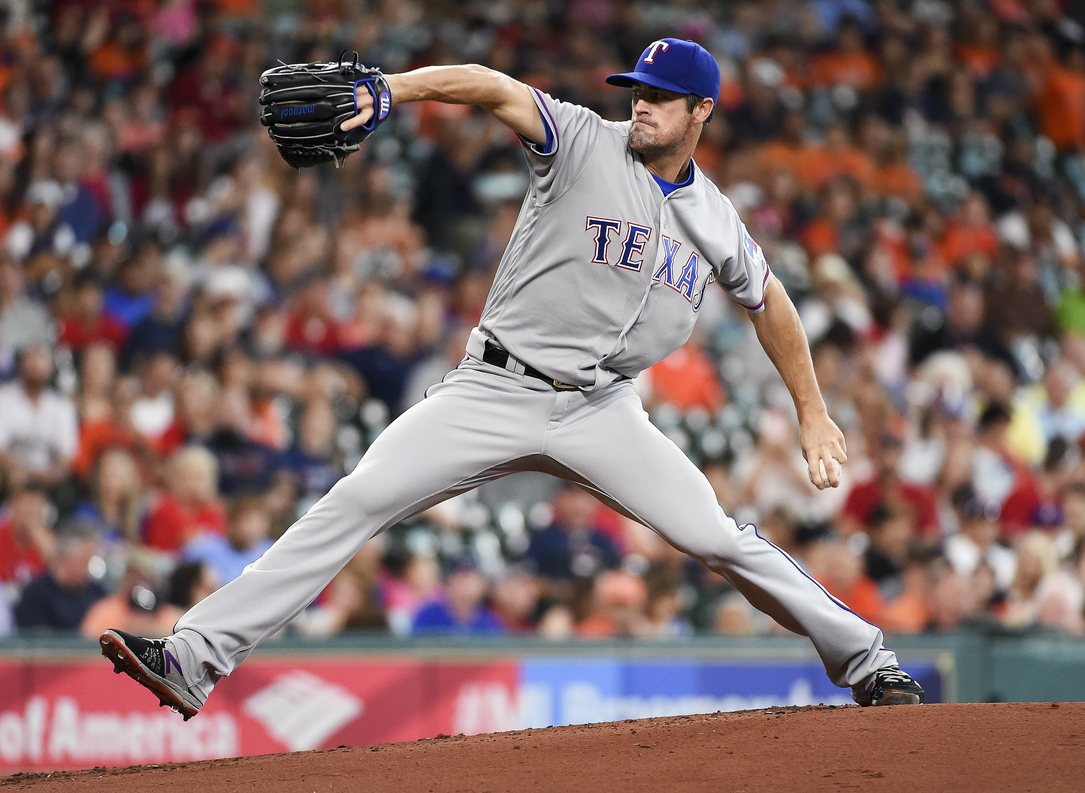 Texas Rangers starting pitcher Cole Hamels delivers during the first inning of a baseball game against the Houston Astros, Sunday, May 22, 2016, in Houston. (AP Photo/Eric Christian Smith)