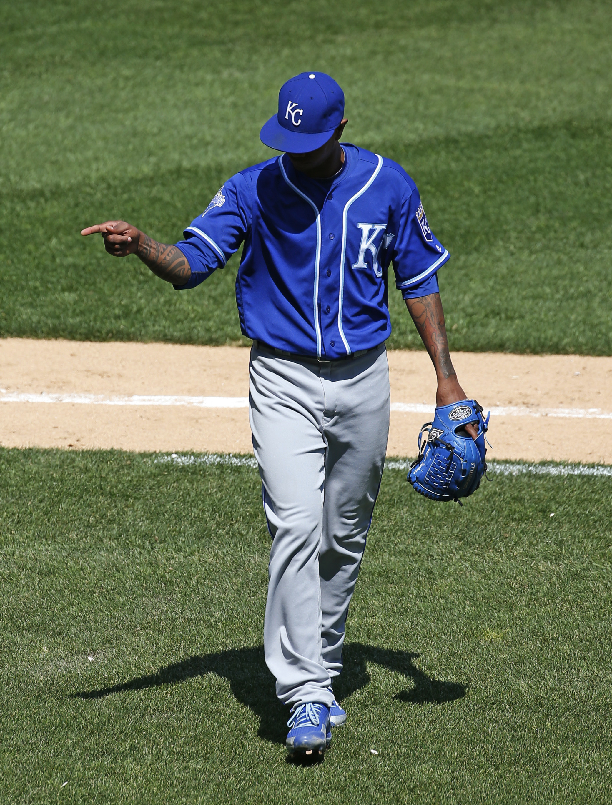 Kansas City Royals starter Yordano Ventura points to the dugout as he walks back to the dugout after bottom of the fifth inning of a baseball game against the Chicago White Sox on Sunday, May 22, 2016, in Chicago. (AP Photo/Nam Y. Huh)
