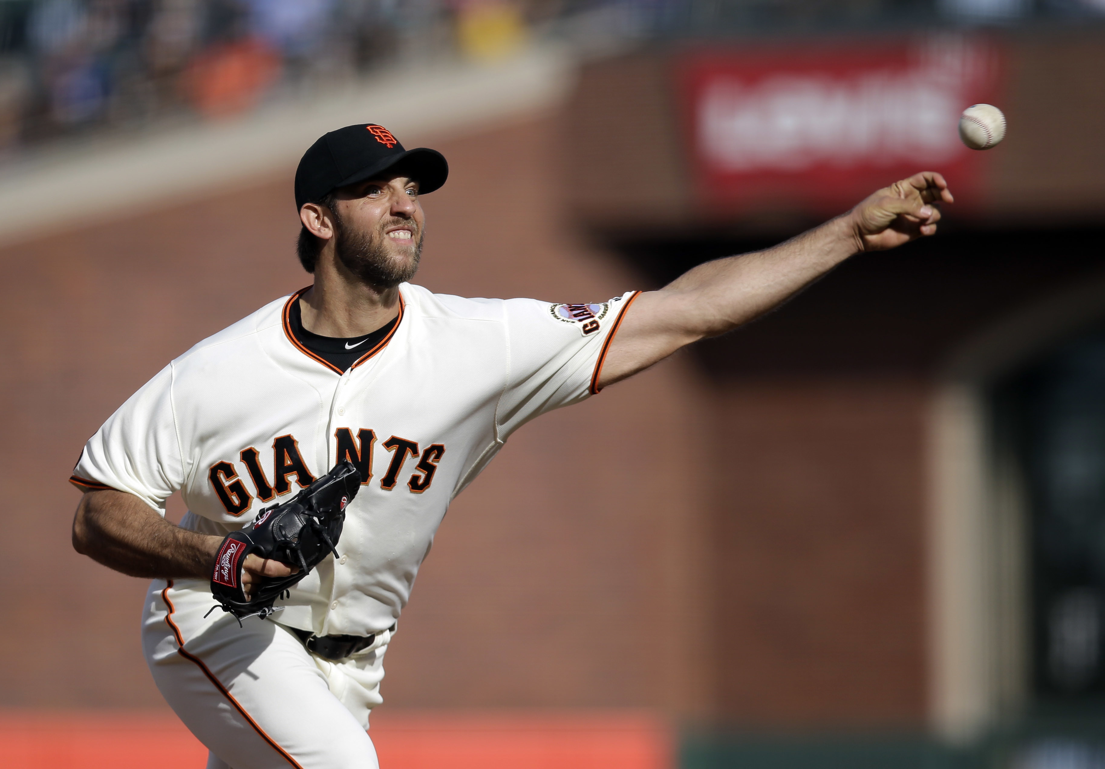 San Francisco Giants starting pitcher Madison Bumgarner throws to the Chicago Cubs during the second inning of a baseball game Sunday, May 22, 2016, in San Francisco. (AP Photo/Marcio Jose Sanchez)