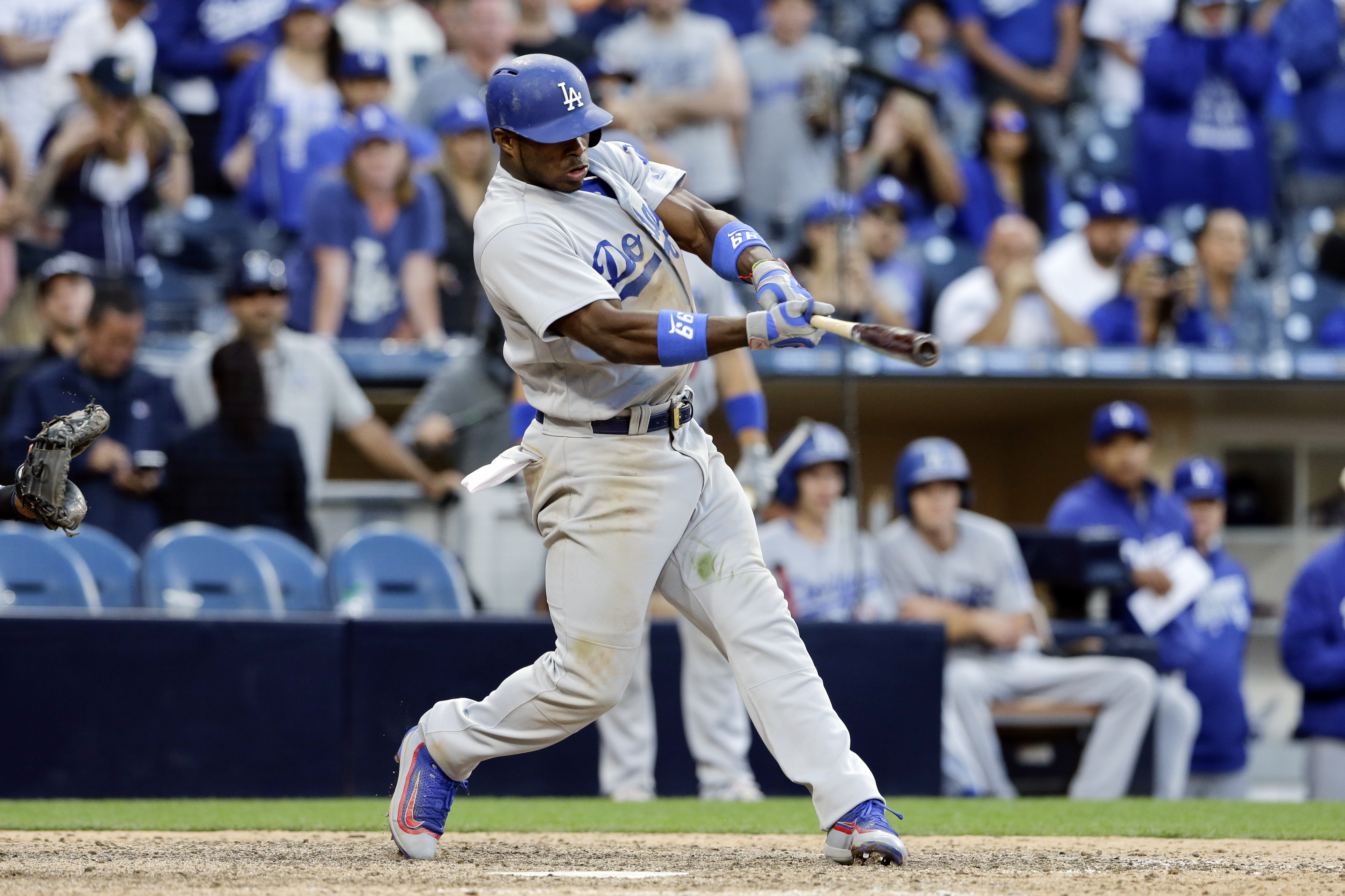 Los Angeles Dodgers' Yasiel Puig hits a two-run single during the seventeenth inning of a baseball game against the San Diego Padres, Sunday, May 22, 2016, in San Diego. (AP Photo/Gregory Bull)