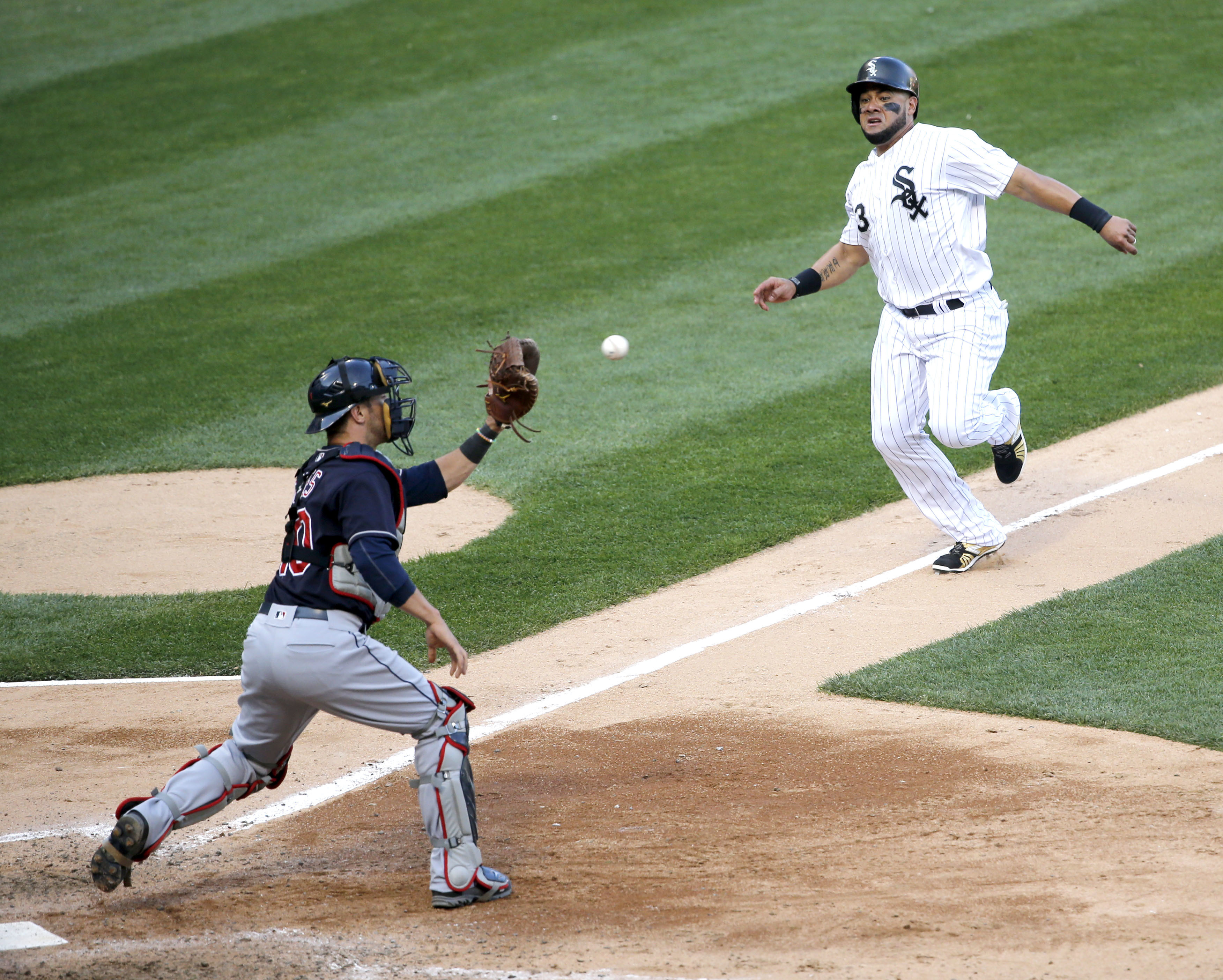 Cleveland Indians catcher Yan Gomes, left, takes a throw from right fielder Michael Martinez and tags out Chicago White Sox's Melky Cabrera at home during the seventh inning of a baseball game Monday, May 23, 2016, in Chicago. (AP Photo/Charles Rex Arboga