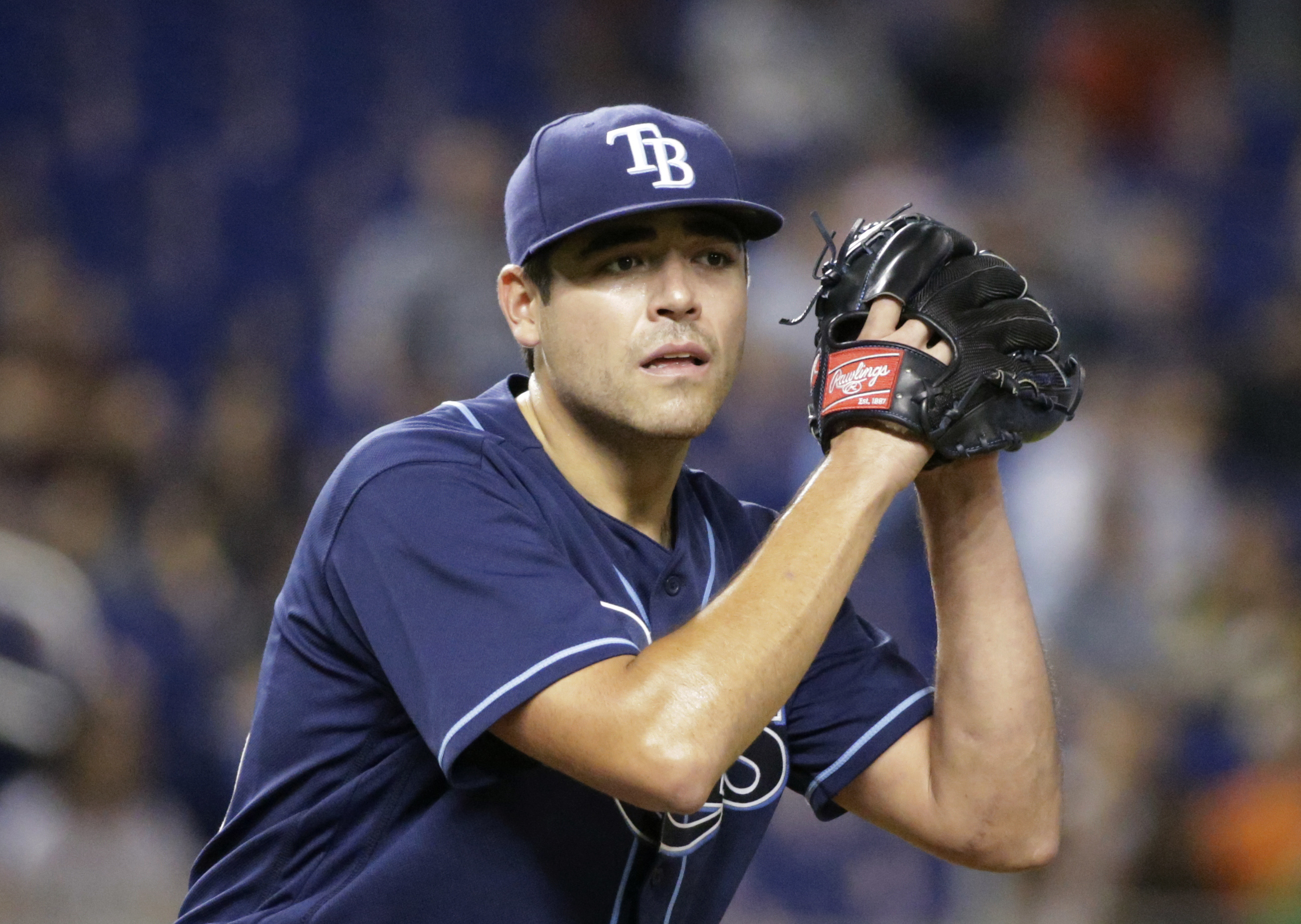Tampa Bay Rays' Matt Moore prepares to deliver a pitch during the first inning of a baseball game against the Miami Marlins, Monday, May 23, 2016, in Miami. (AP Photo/Wilfredo Lee)