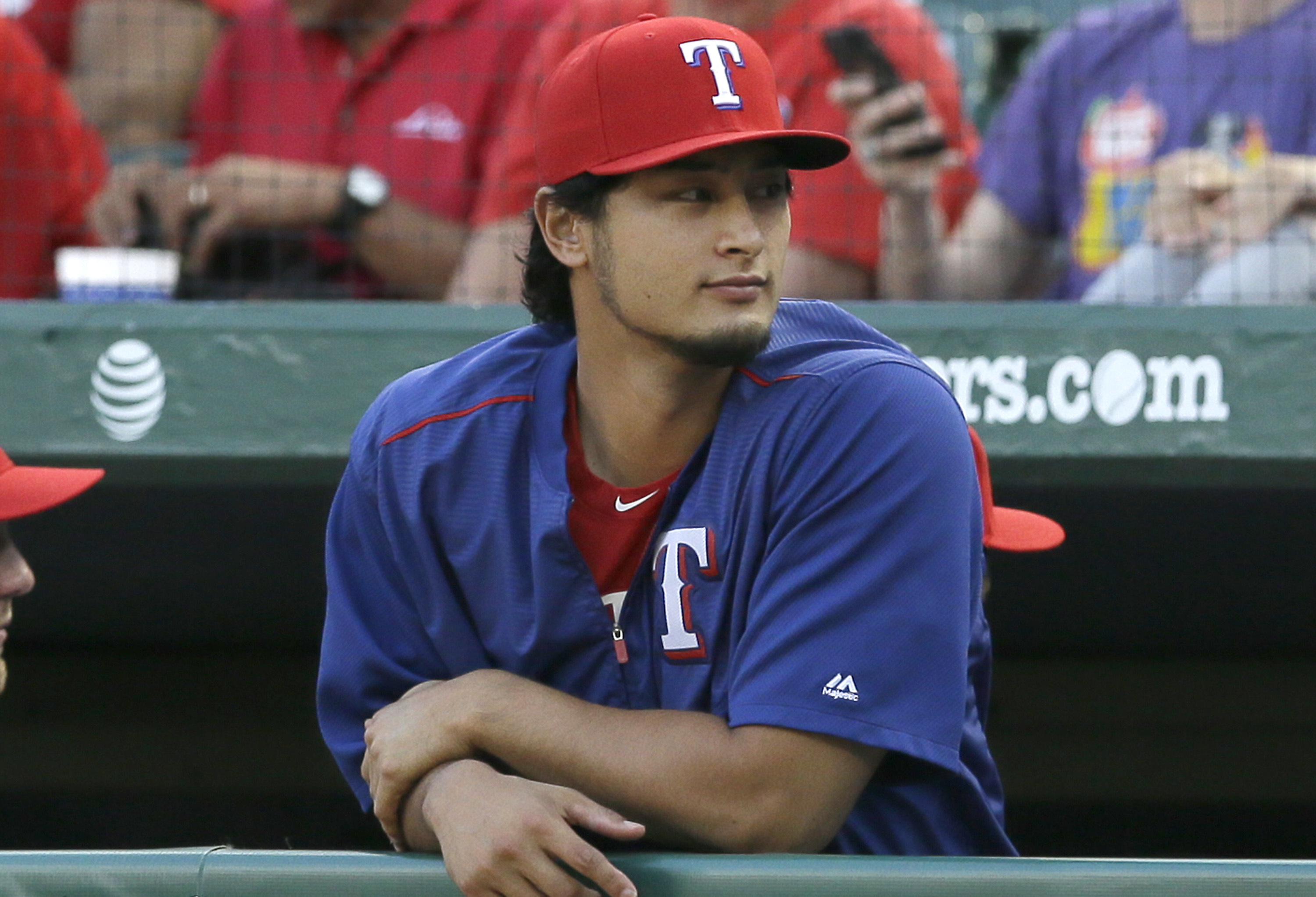 Texas Rangers pitcher Yu Darvish of Japan watches from the dugout during the first inning of a baseball game against the Los Angeles Angels in Arlington, Texas, Monday, May 23, 2016. (AP Photo/LM Otero)