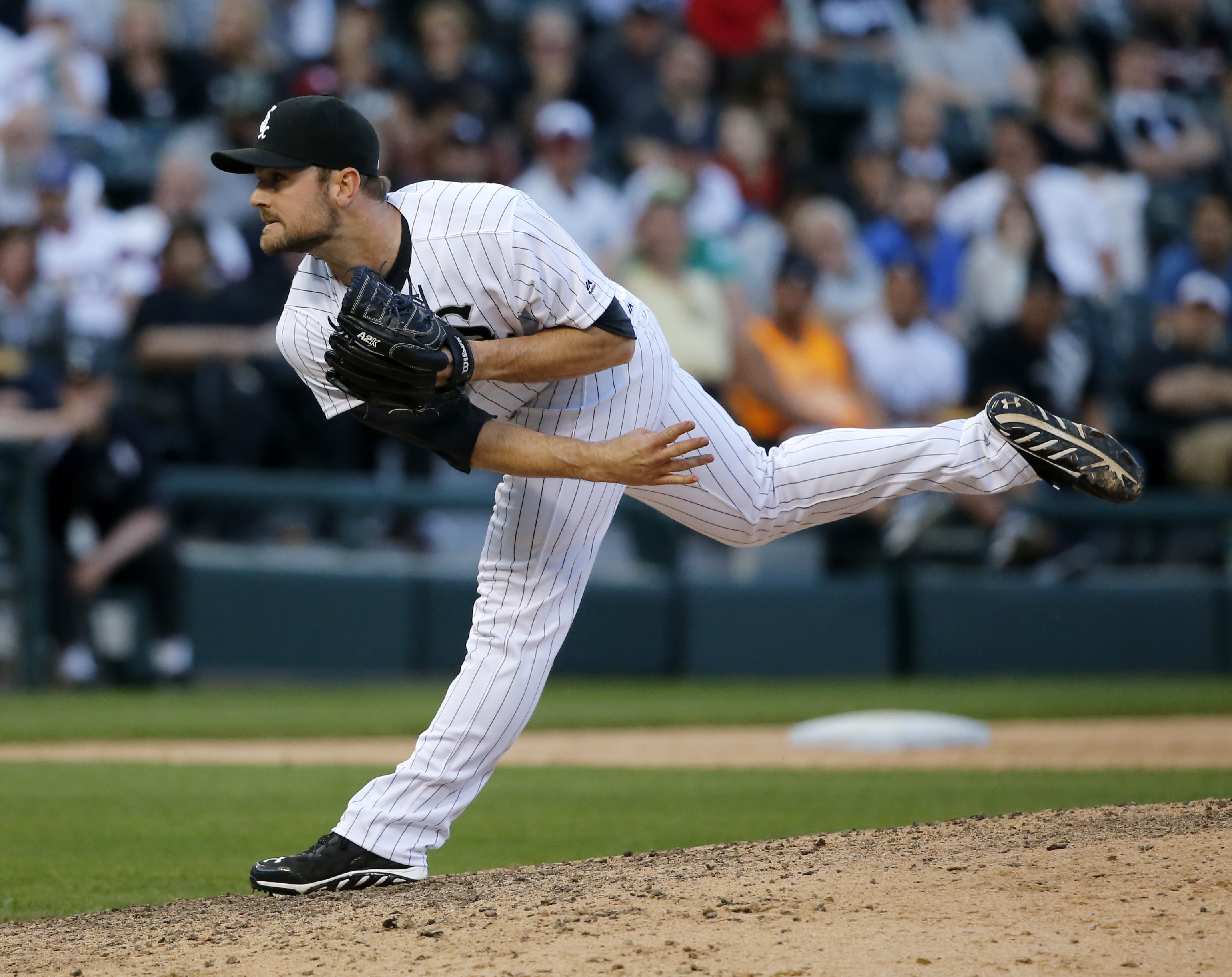 Chicago White Sox relief pitcher David Robertson follows through with a pitch during the ninth inning of a baseball game and the White Sox's 7-6 win over the Cleveland Indians Monday, May 23, 2016, in Chicago. (AP Photo/Charles Rex Arbogast)