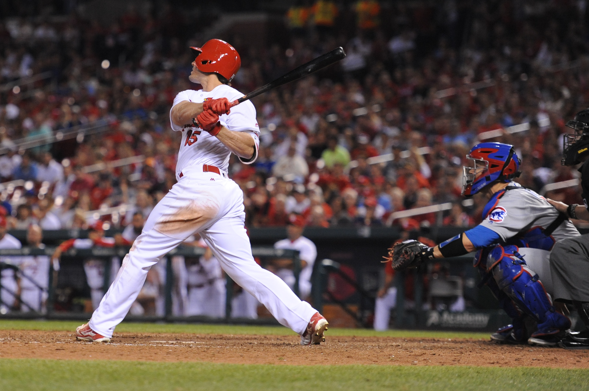 St. Louis Cardinals' Randal Grichuk (15) hits a walk-off home run in the ninth inning of a baseball game against the Chicago Cubs on Monday, May 23, 2016, in St. Louis. The Cardinals defeated the Cubs 4-3. (AP Photo/Michael Thomas)