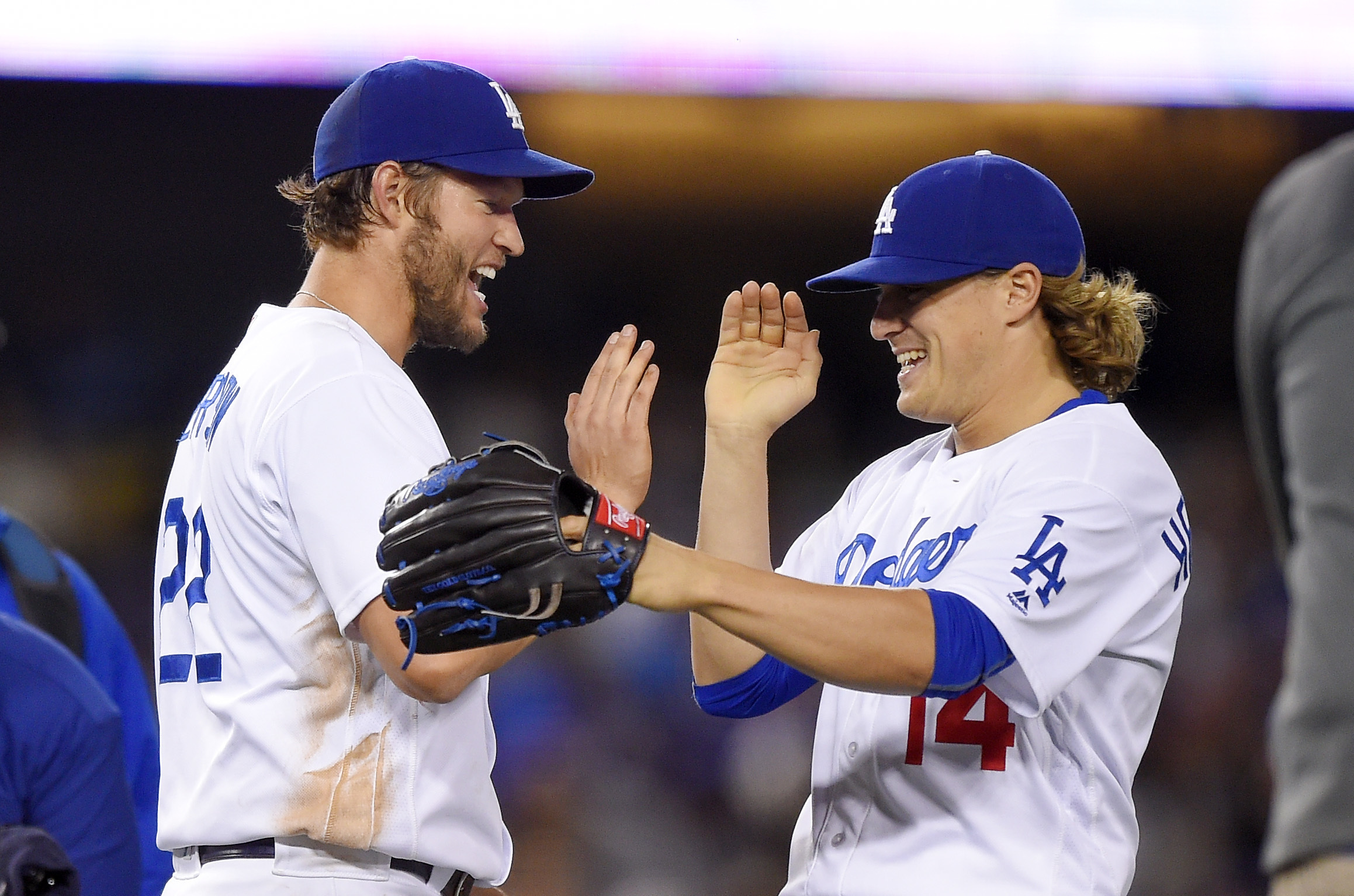 Los Angeles Dodgers starting pitcher Clayton Kershaw, left, and Enrique Hernandez congratulate each other after the Dodgers defeated the Cincinnati Reds 1-0 in a baseball game Monday, May 23, 2016, in Los Angeles. (AP Photo/Mark J. Terrill)