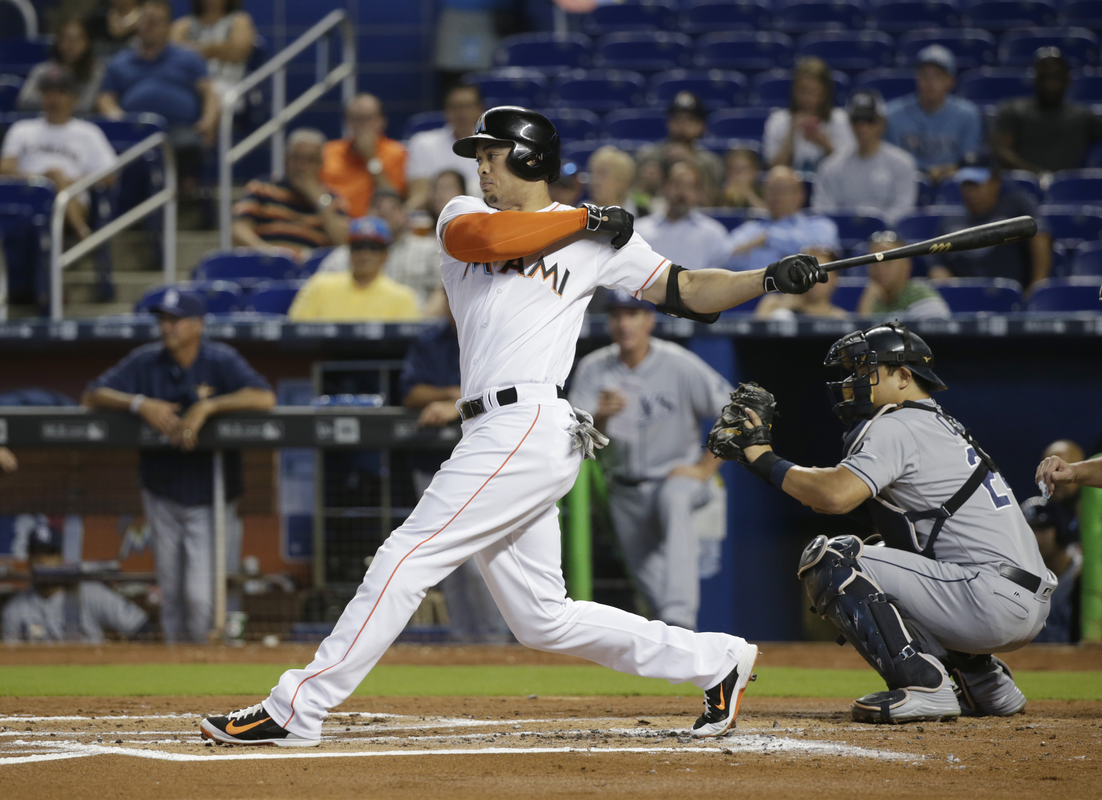 Miami Marlins' Giancarlo Stanton strikes out during the first inning of a baseball game against the Tampa Bay Rays, Tuesday, May 24, 2016, in Miami. (AP Photo/Wilfredo Lee)
