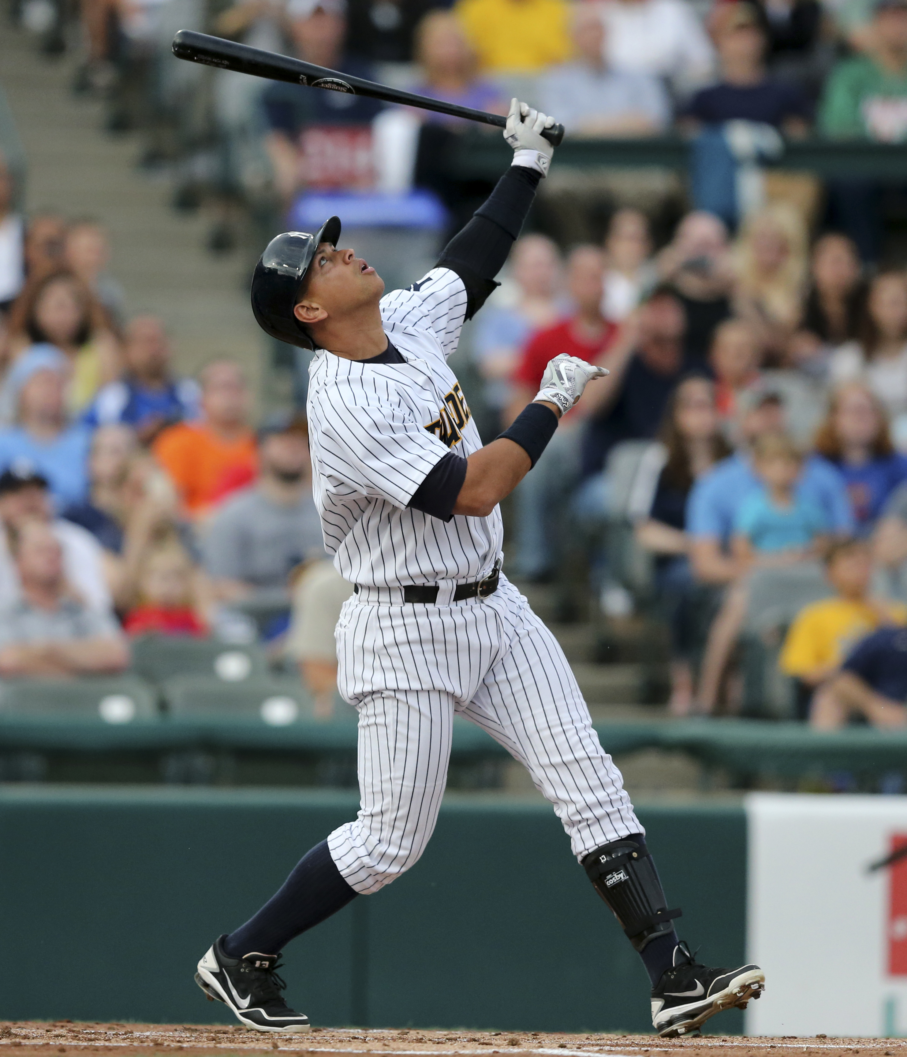 New York Yankees third baseman Alex Rodriguez watches his pop-up during a minor league rehab start for the Trenton Thunder, against the New Hampshire Fisher Cats on Tuesday, May 24, 2016, in Trenton, N.J. (AP Photo/Mel Evans)