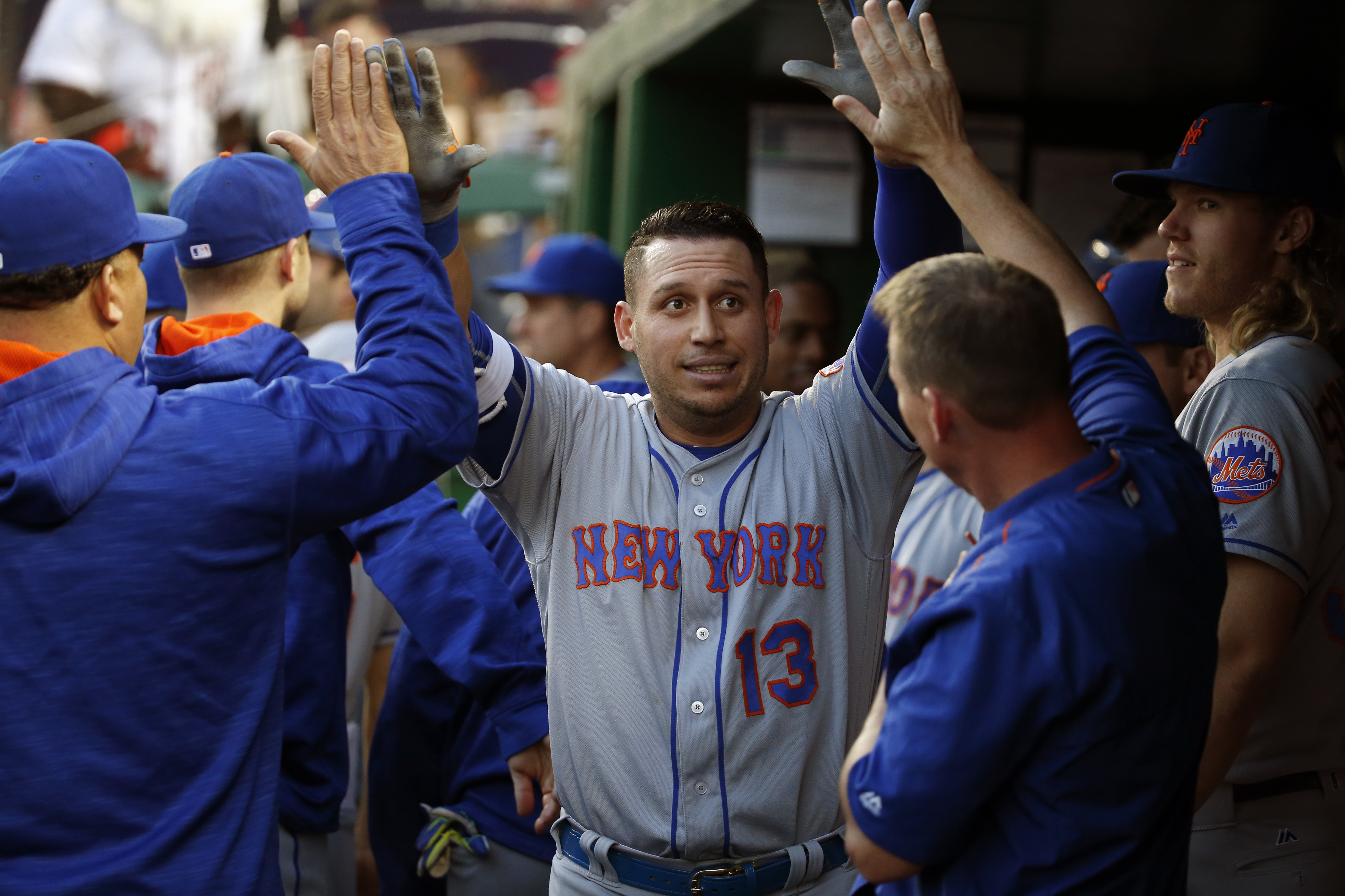 New York Mets' Asdrubal Cabrera (13) is congratulated on his solo home run during the fourth inning of a baseball game against the Washington Nationals at Nationals Park, Tuesday, May 24, 2016, in Washington. (AP Photo/Alex Brandon)