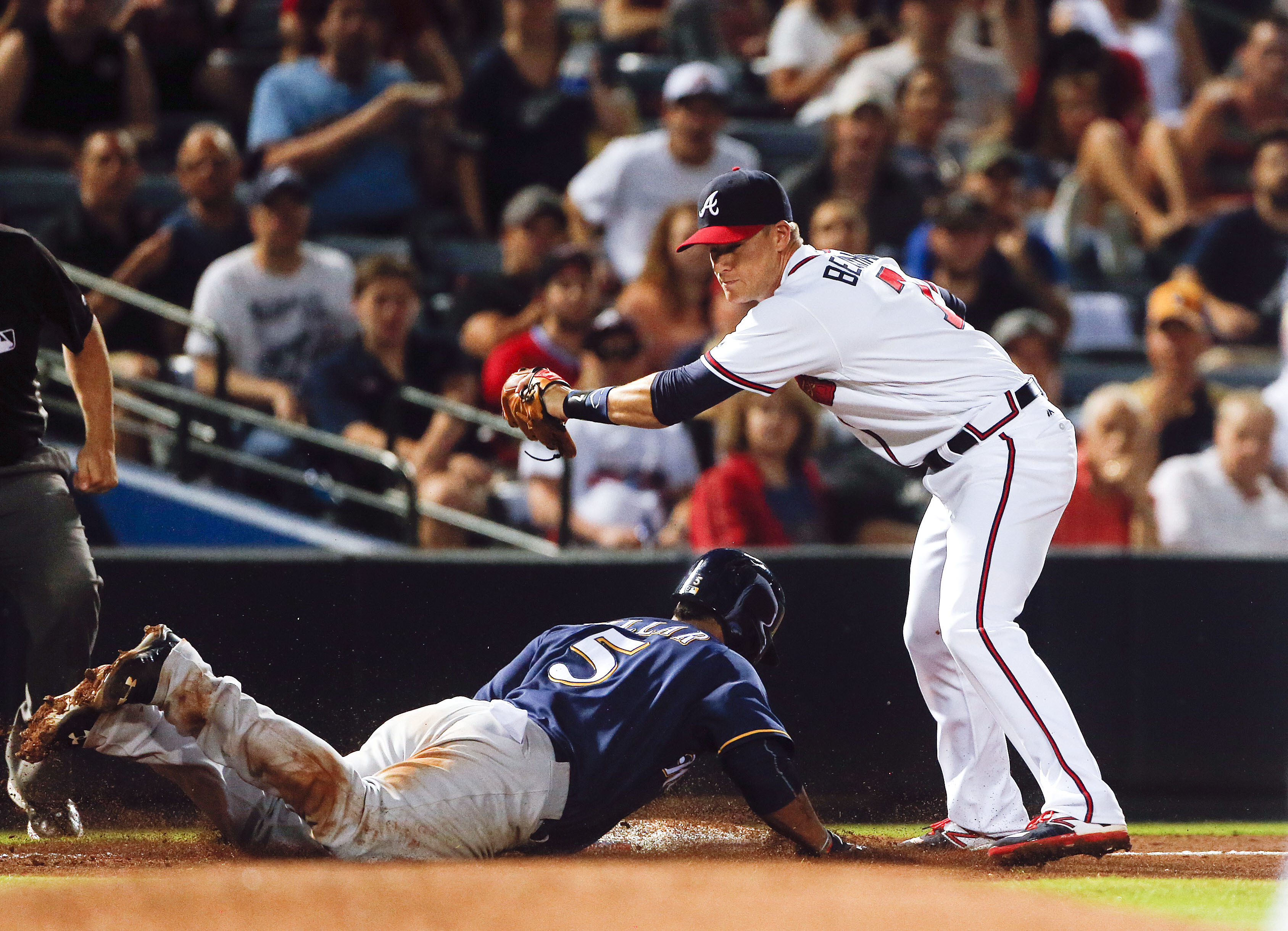 Milwaukee Brewers' Jonathan Villar (5) is tagged out at third by Atlanta Braves third baseman Gordon Beckham (7) on a Ryan Braun ground ball in the sixth inning of baseball game Tuesday, May 24, 2016, in Atlanta. (AP Photo/John Bazemore)