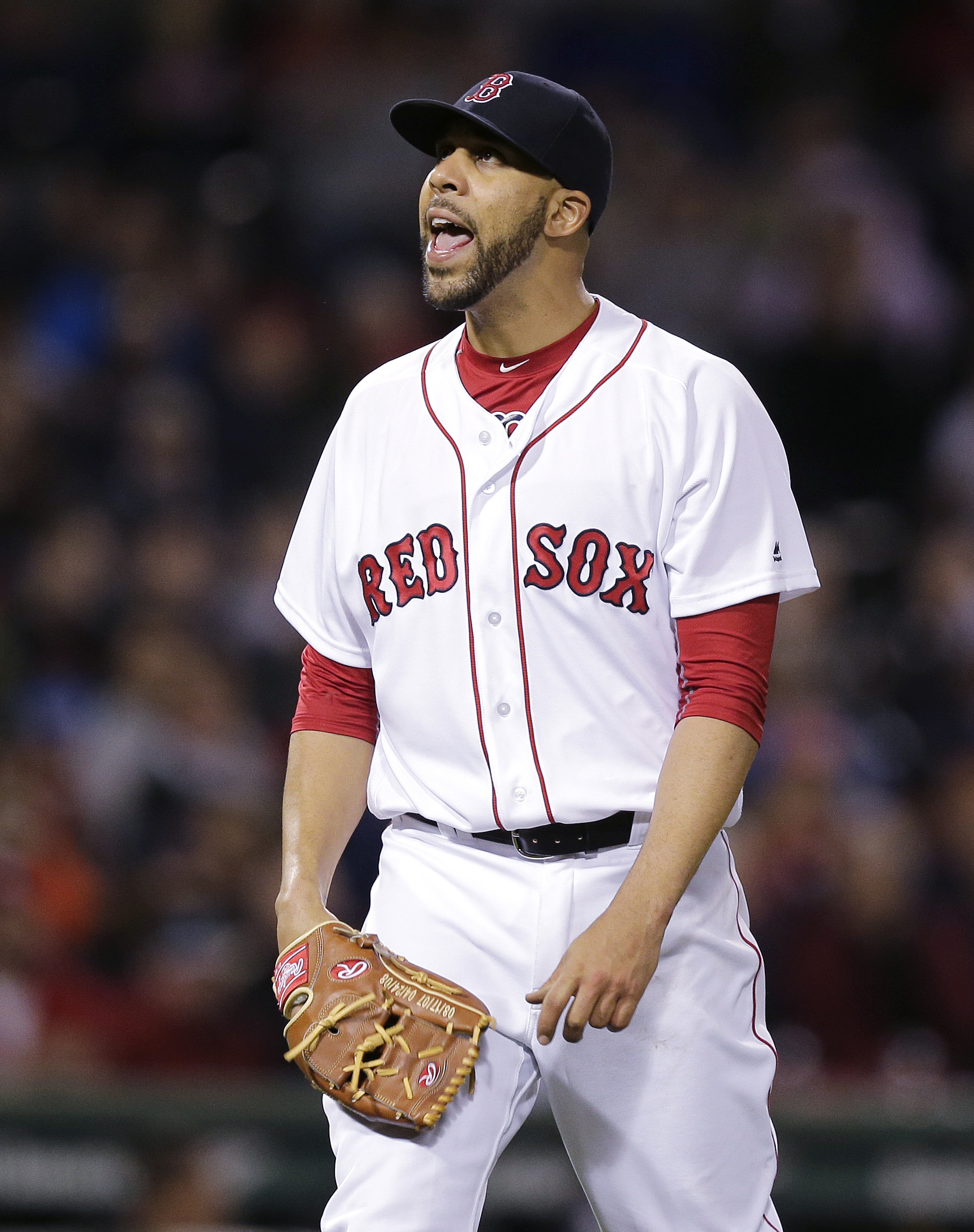 Boston Red Sox starting pitcher David Price yells as he heads to the dugout after pitching the sixth inning of a baseball game against the Colorado Rockies in Boston, Tuesday, May 24, 2016. (AP Photo/Charles Krupa)