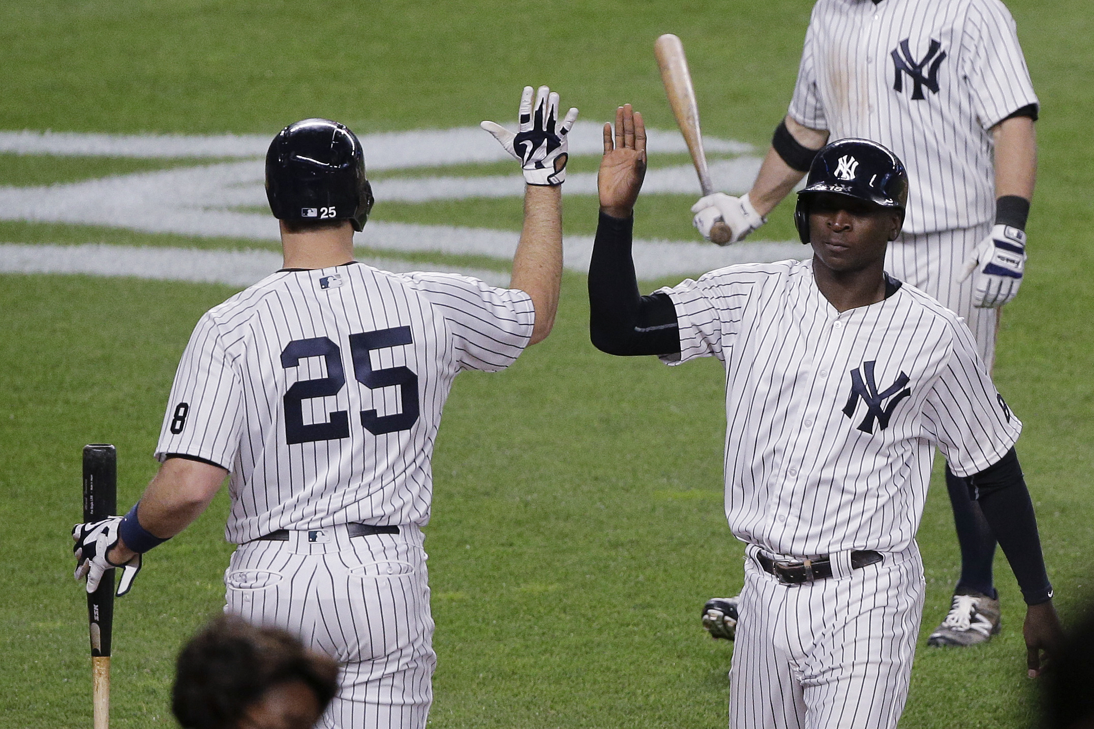 New York Yankees' Didi Gregorius, right, is greeted by Mark Teixeira (25) after scoring on an infield hit by Jacoby Ellsbury against the Toronto Blue Jays during the seventh inning of a baseball game, Tuesday, May 24, 2016, in New York. (AP Photo/Julie Ja