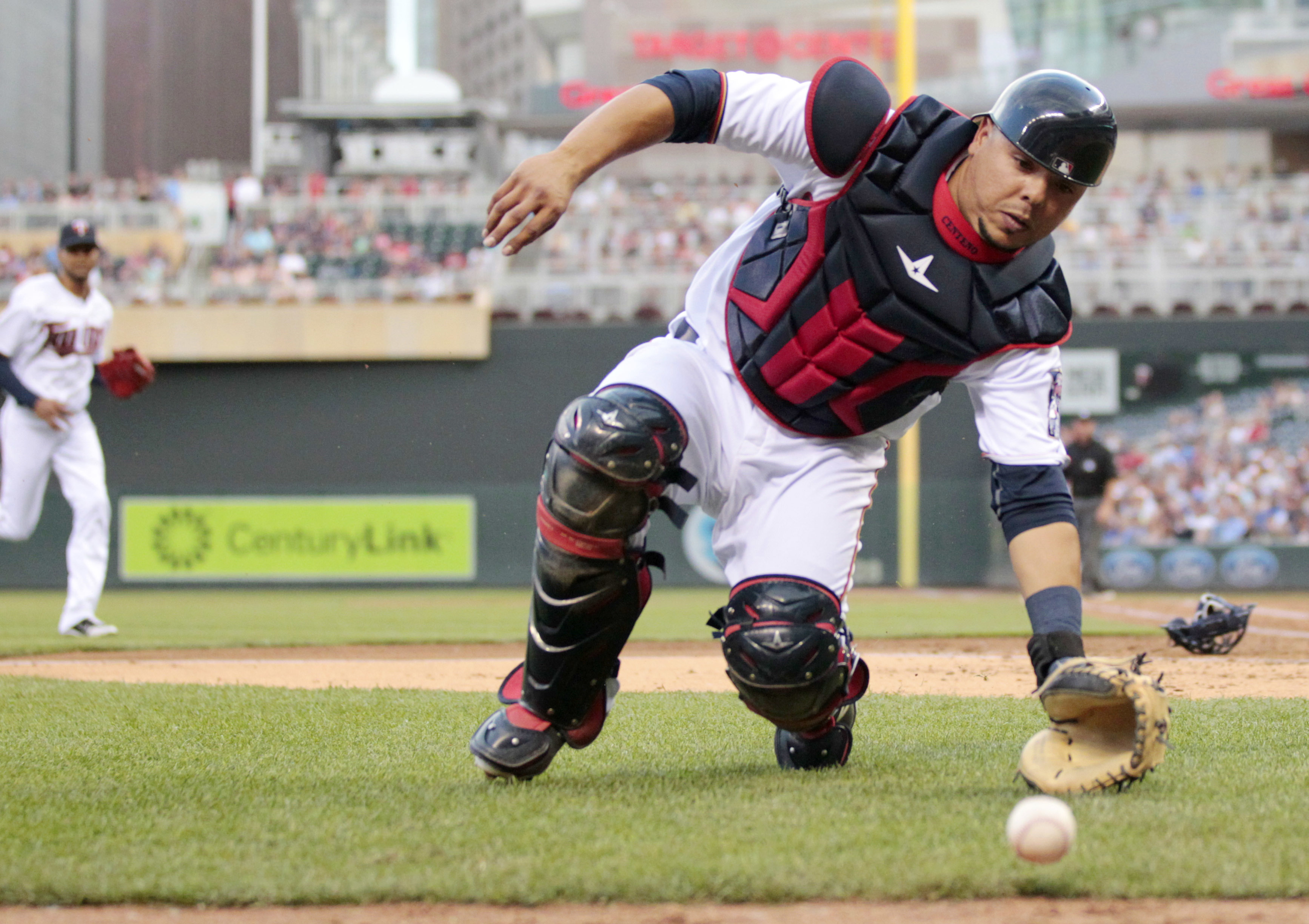 Minnesota Twins catcher Juan Centeno chases the ball down as Twins pitcher Ervin Santana runs to the plate too late to stop Kansas City Royals Cheslor Cuthbert from scoring in the fourth inning during a baseball game on Tuesday, May, 24, 2016 in Minneapol