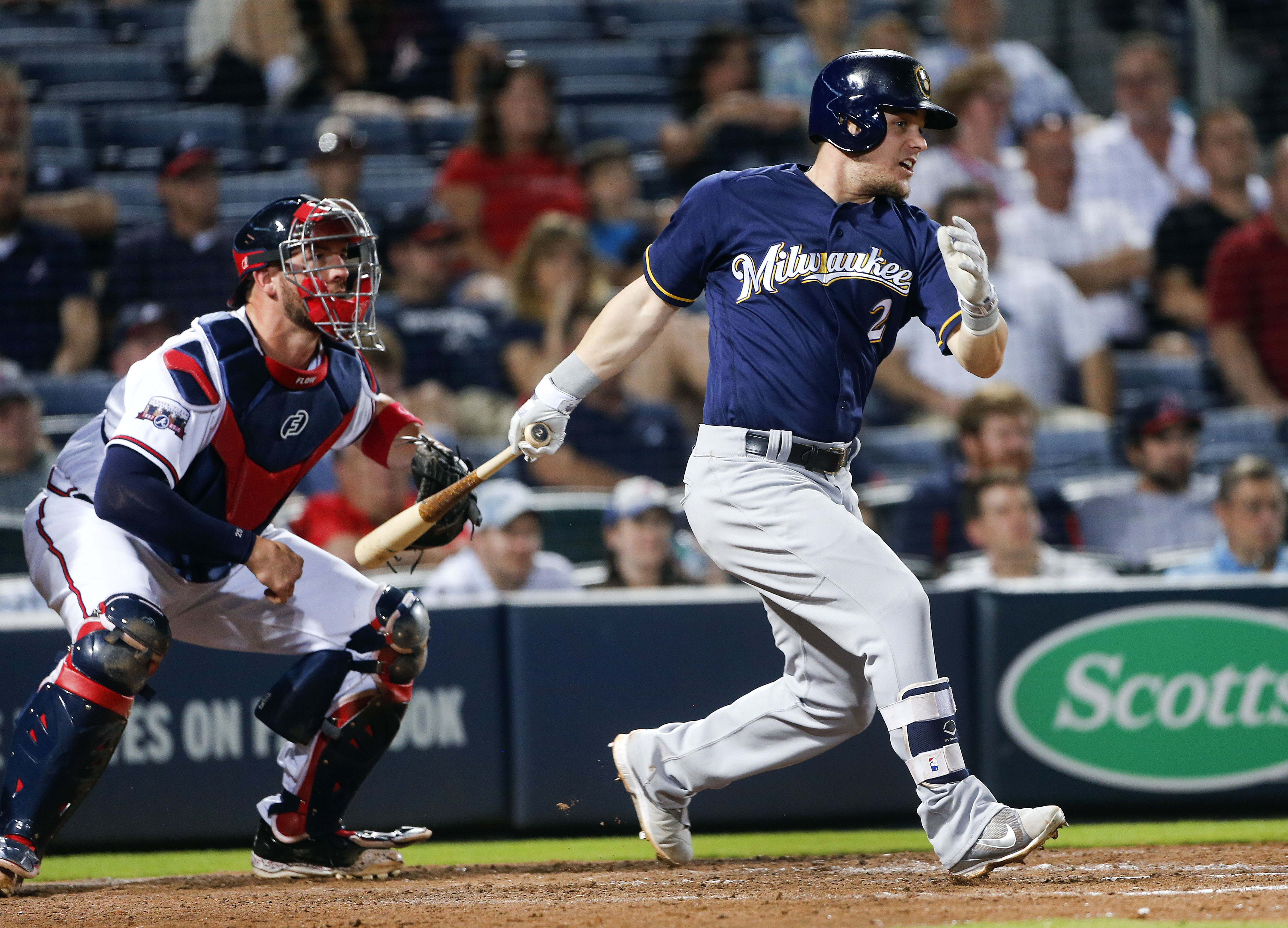 Milwaukee Brewers' Scooter Gennett (2) drives in the game-winning run with a base hit as Atlanta Braves catcher Tyler Flowers (25) looks on in the eighth inning of baseball game Tuesday, May 24, 2016, in Atlanta. (AP Photo/John Bazemore)