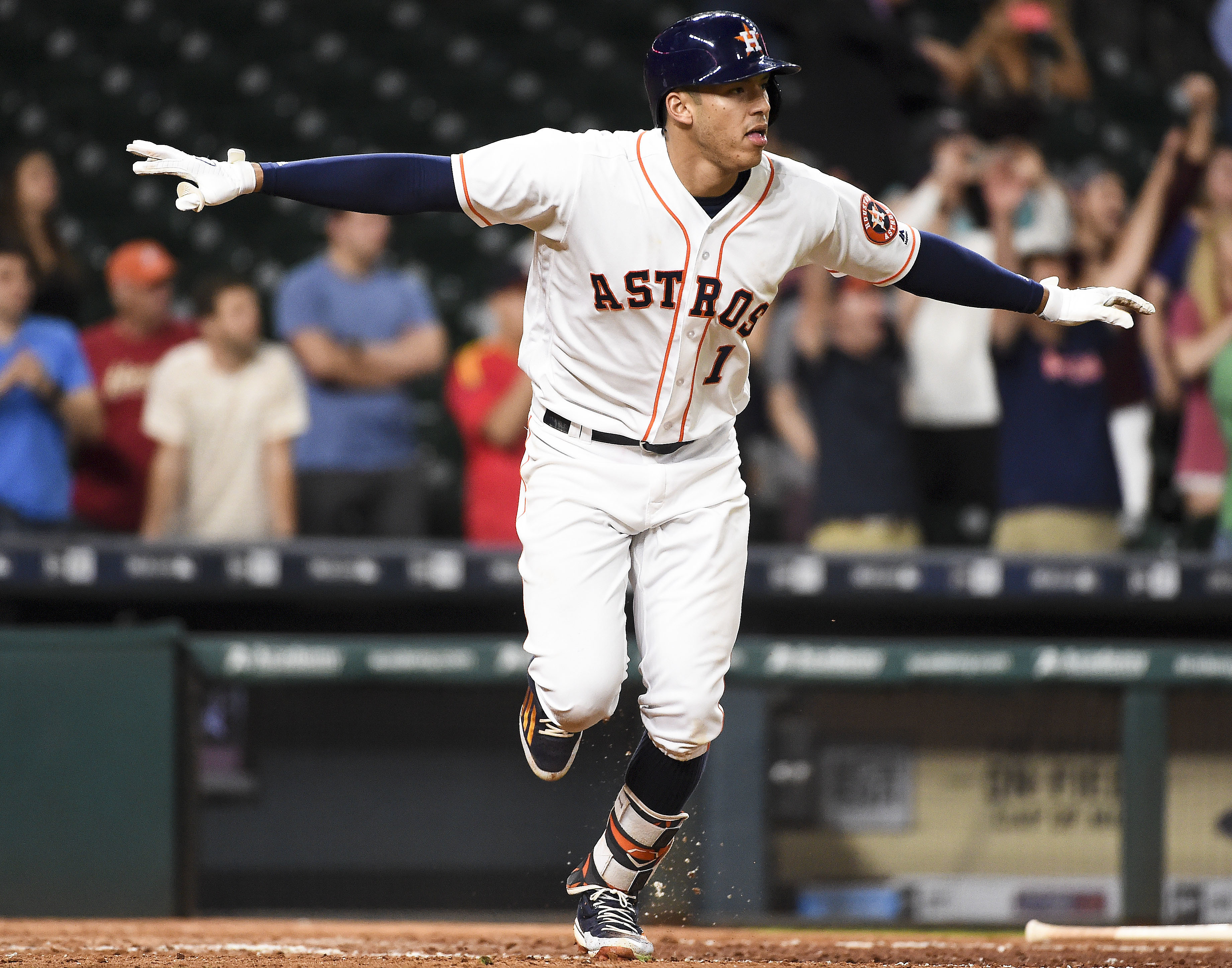 Houston Astros' Carlos Correa (1) gestures after hitting the game-winning RBI single during the 13th inning of a baseball game against the Baltimore Orioles, Tuesday, May 24, 2016, in Houston. Houston won 3-2. (AP Photo/Eric Christian Smith)