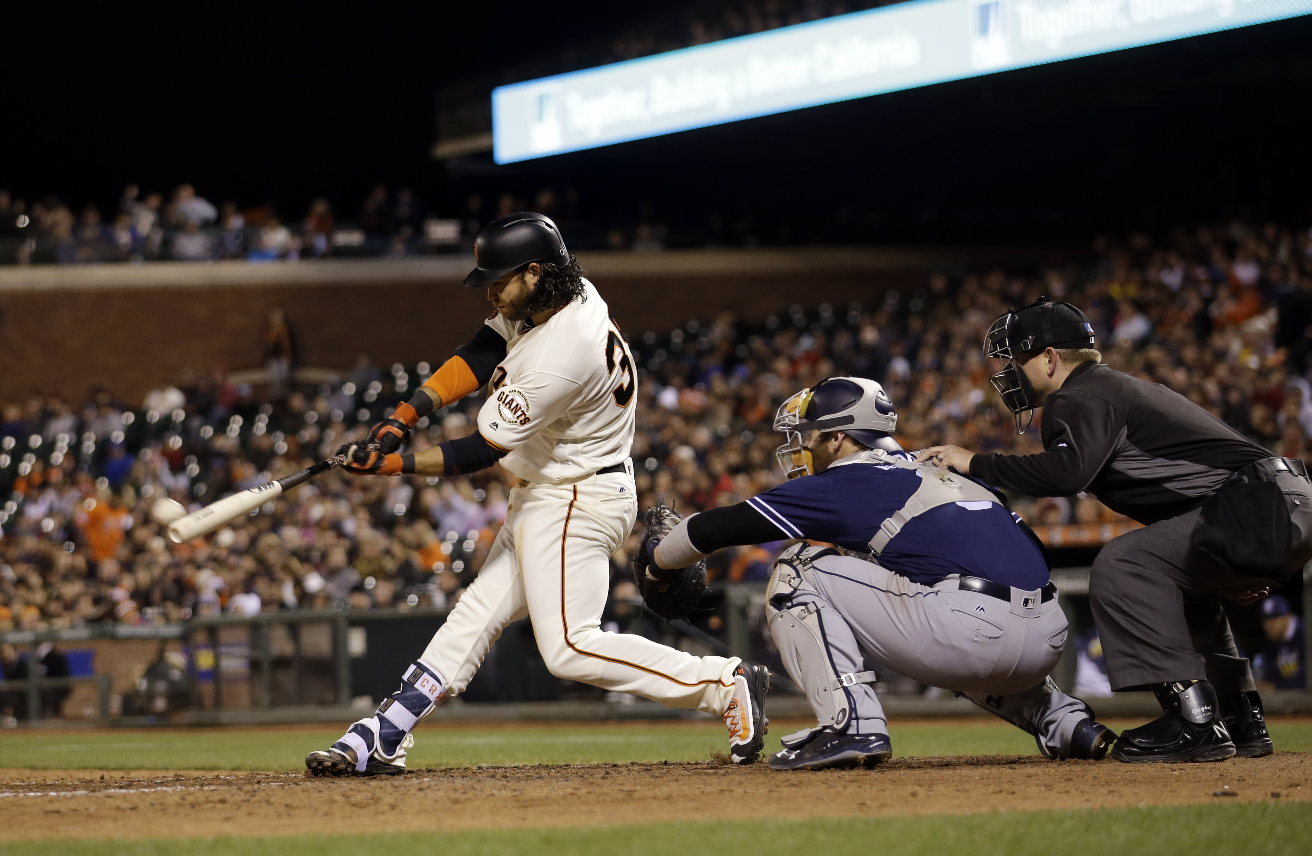 San Francisco Giants' Brandon Crawford drives in three runs with a bases-loaded triple during the eighth inning of a baseball game against the San Diego Padres Tuesday, May 24, 2016, in San Francisco. (AP Photo/Marcio Jose Sanchez)