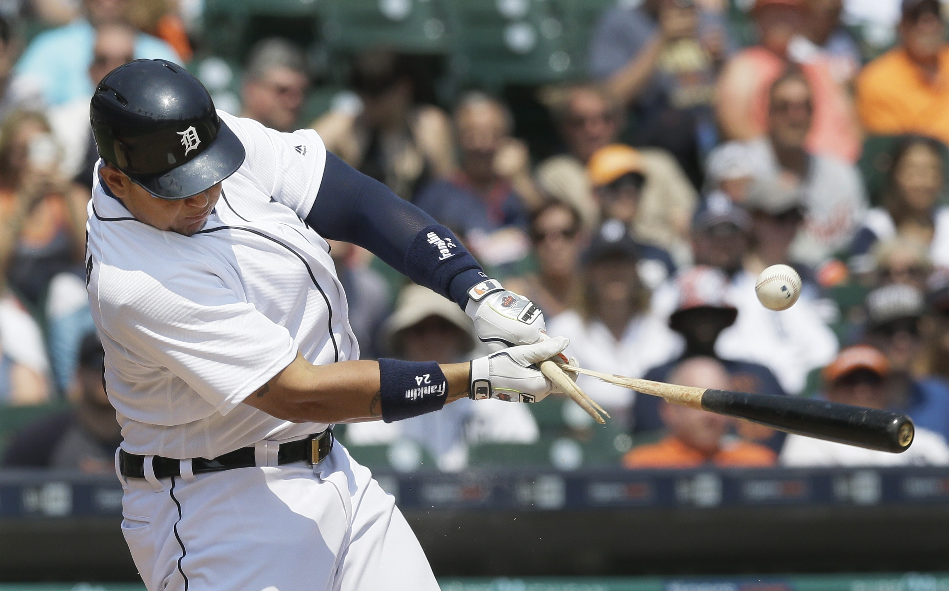Detroit Tigers' Miguel Cabrera breaks his bat as he pops up during the fifth inning of a baseball game against the Philadelphia Phillies, Wednesday, May 25, 2016, in Detroit. (AP Photo/Carlos Osorio)