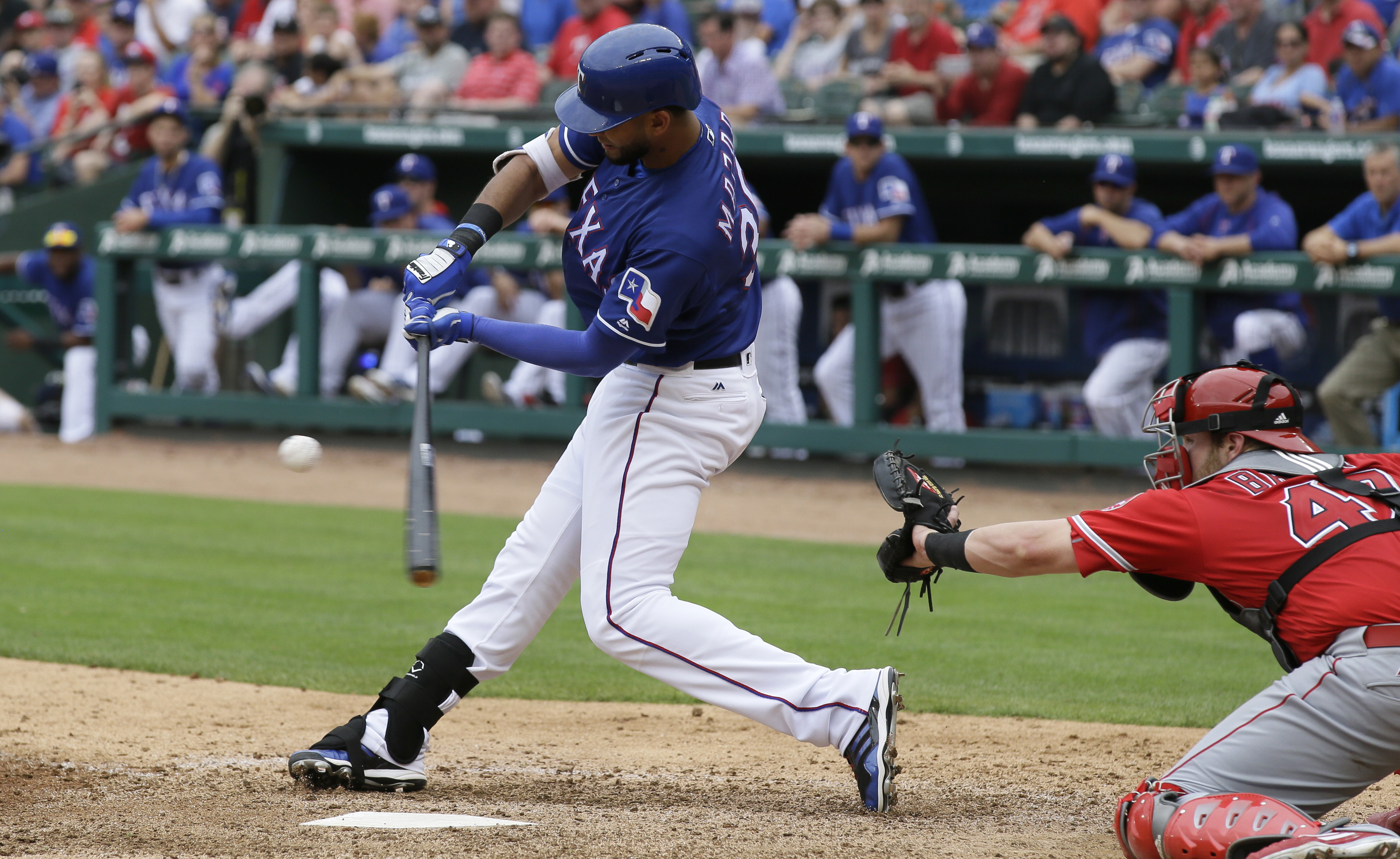 Texas Rangers Nomar Mazara (30) hits an RBI single in front of Los Angeles Angels catcher Jett Bandy (47) during the sixth inning of a baseball game in Arlington, Texas, Wednesday, May 25, 2016. Rangers' Rougned Odor scored on the play. (AP Photo/LM Otero